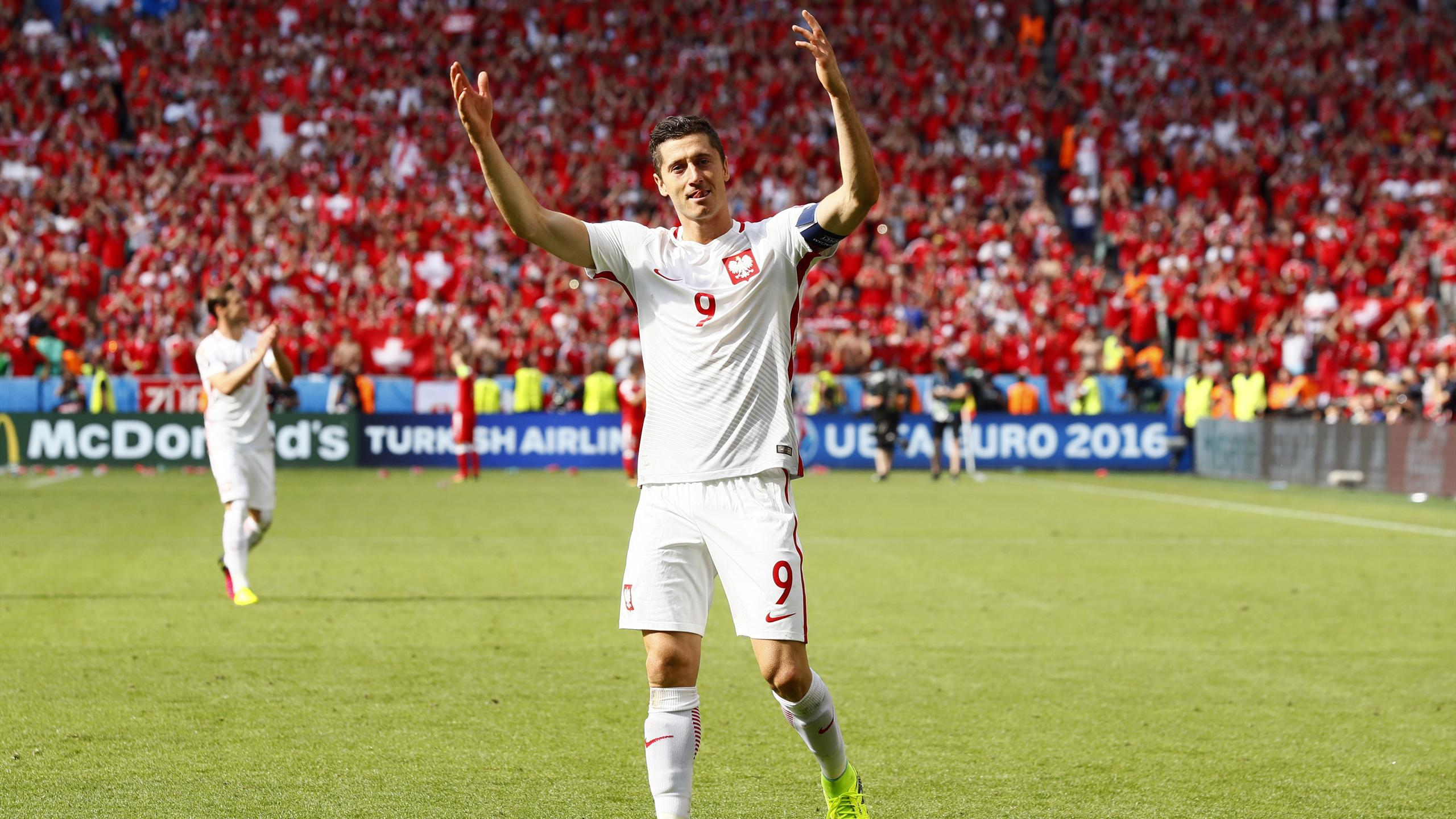Poland's Robert Lewandowski celebrates after the penalty shootout and winning the match