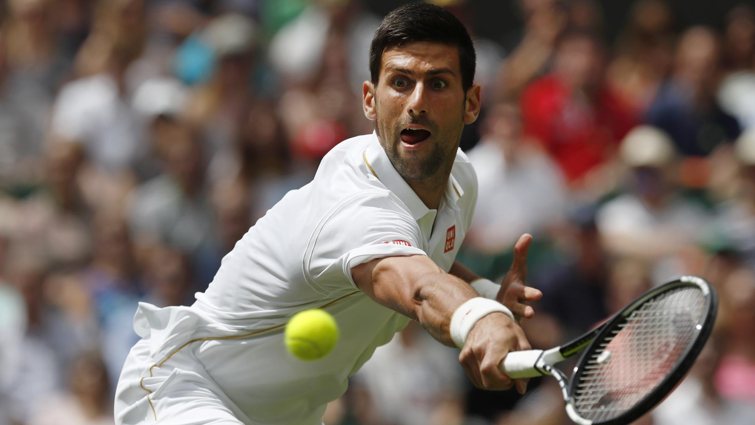Serbia's Novak Djokovic in action against Great Britain's James Ward
