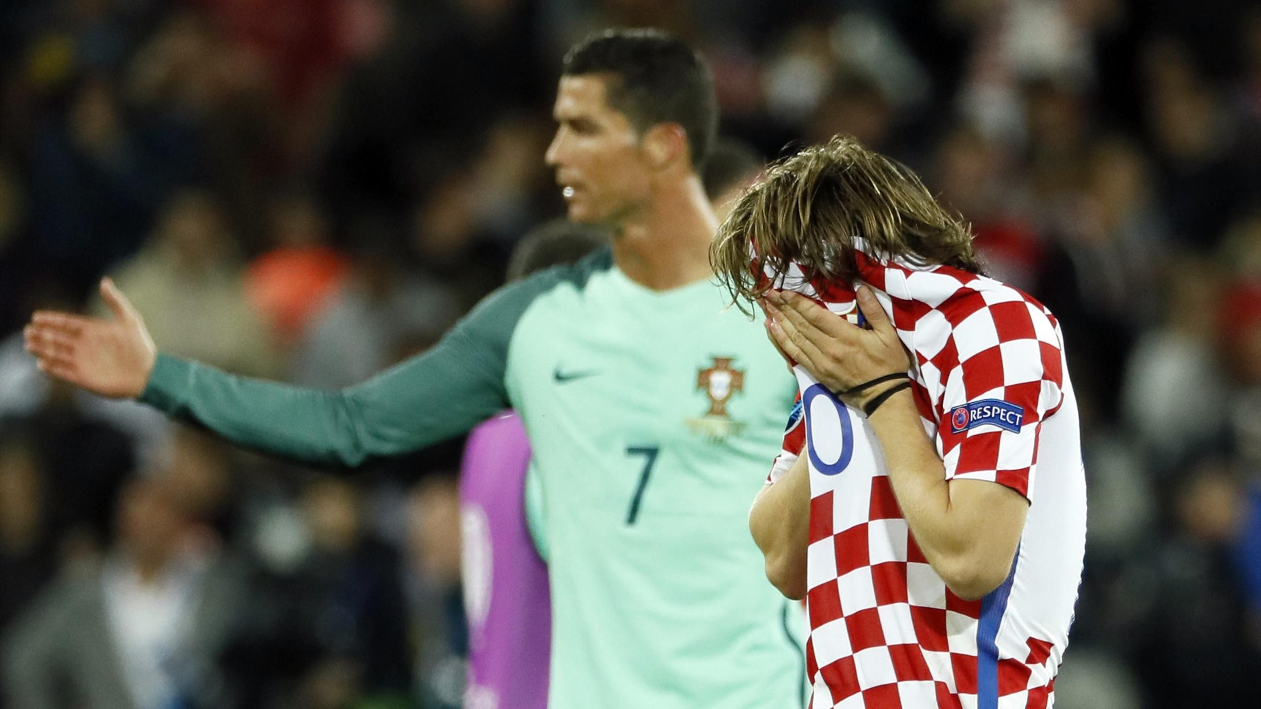 Croatia's Luka Modric reacts as Portugal's Cristiano Ronaldo looks on after the game at Euro 2016