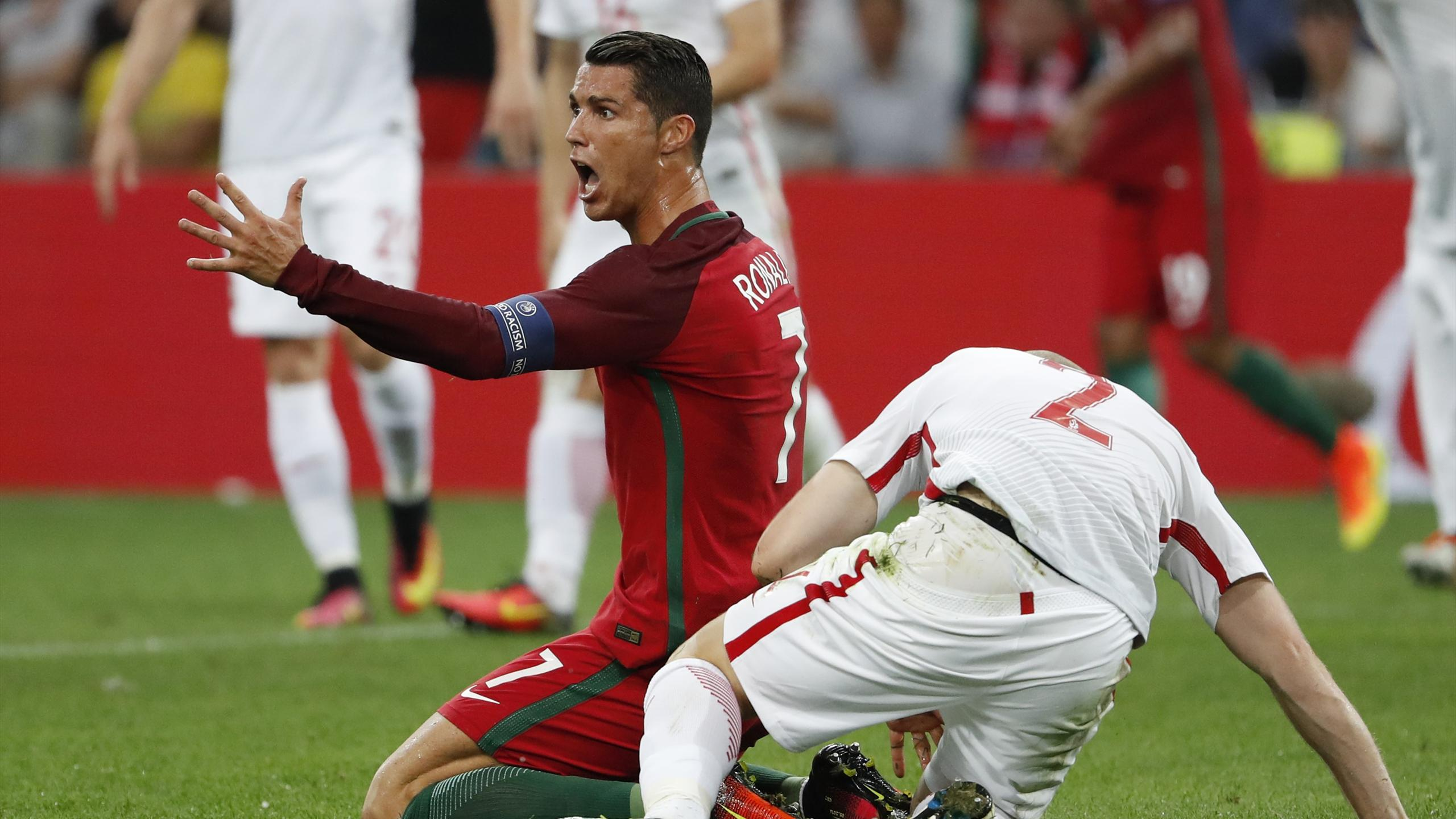 Portugal's Cristiano Ronaldo reacts after a challenge from Poland's Michal Pazdan