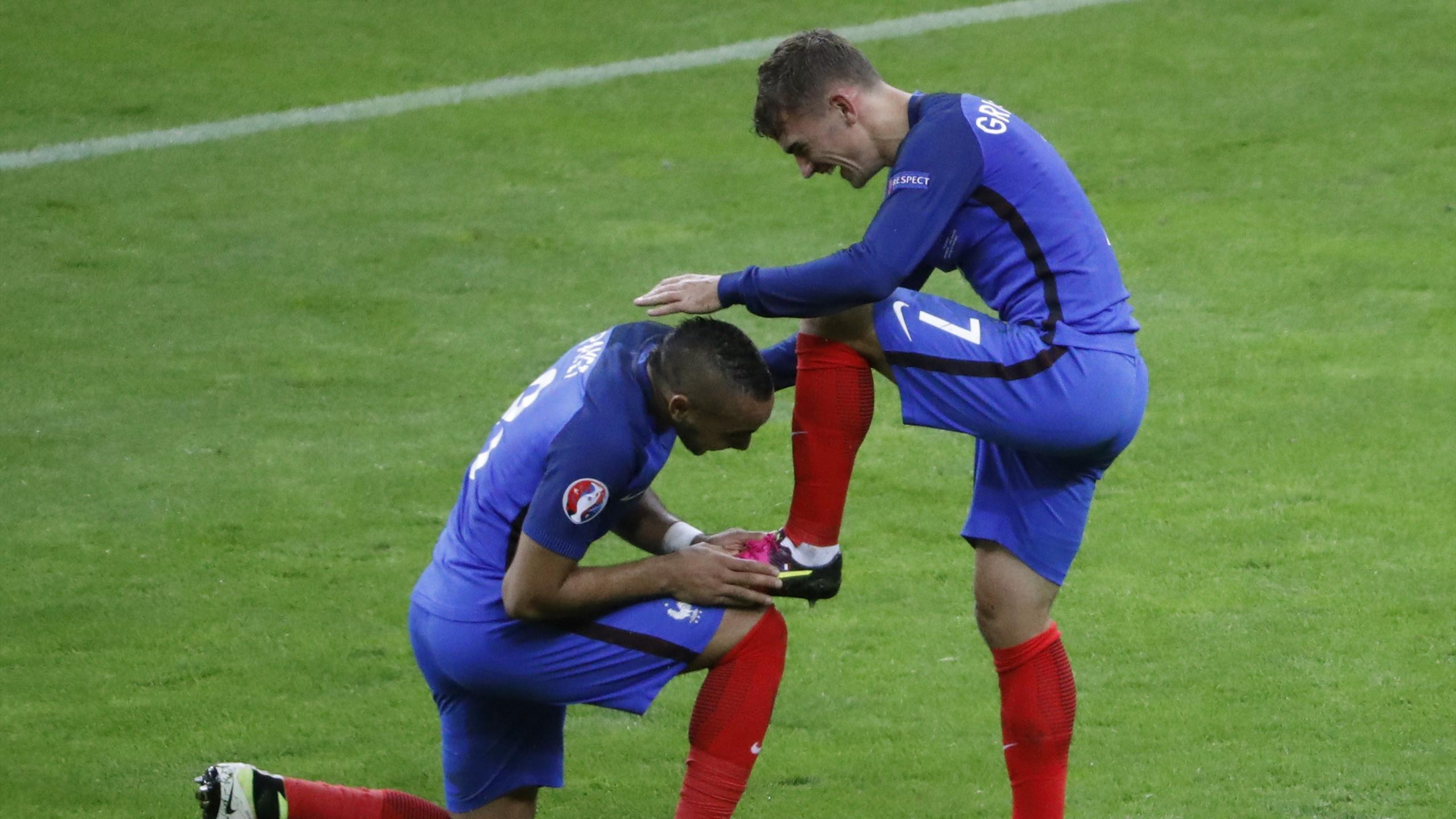 France's Dimitri Payet kisses the boot of Antoine Griezmann
