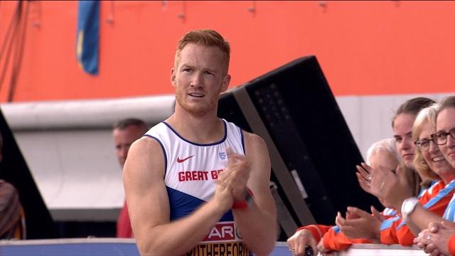 Greg Rutherford cheers on his main rival on final jump