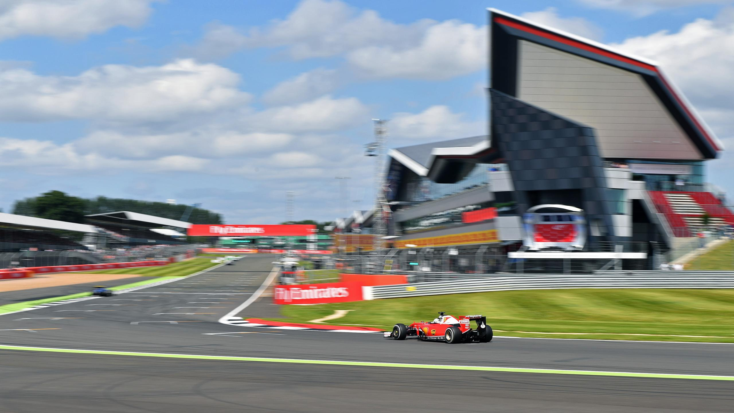 Ferrari's German driver Sebastian Vettel drives during the third practice session during at Silverstone motor racing circuit in Silverstone, central England, on July 9, 2016
