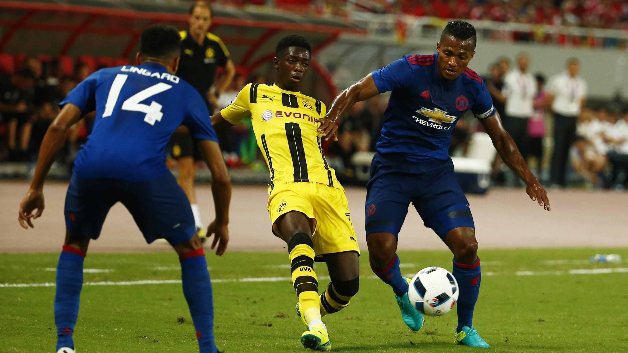 Manchester United's Antonio Valencia in action with Borussia Dortmund's Ousmane Dembele