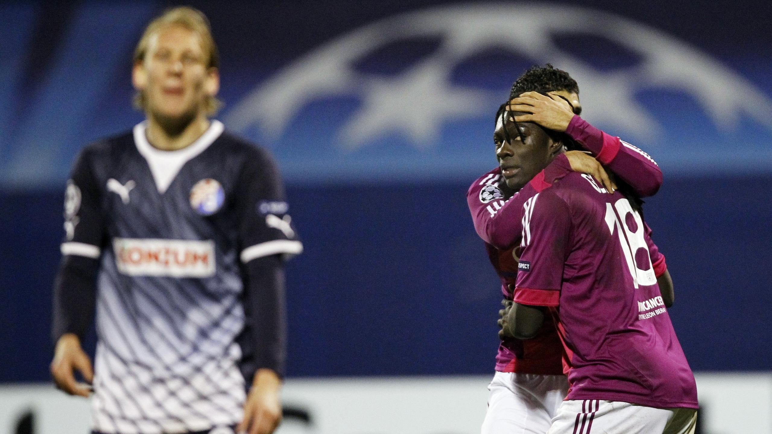 Lyon's Bafetimbi Gomis (R) celebrates after scoring against Dinamo Zagreb during their Champions League Group D clash