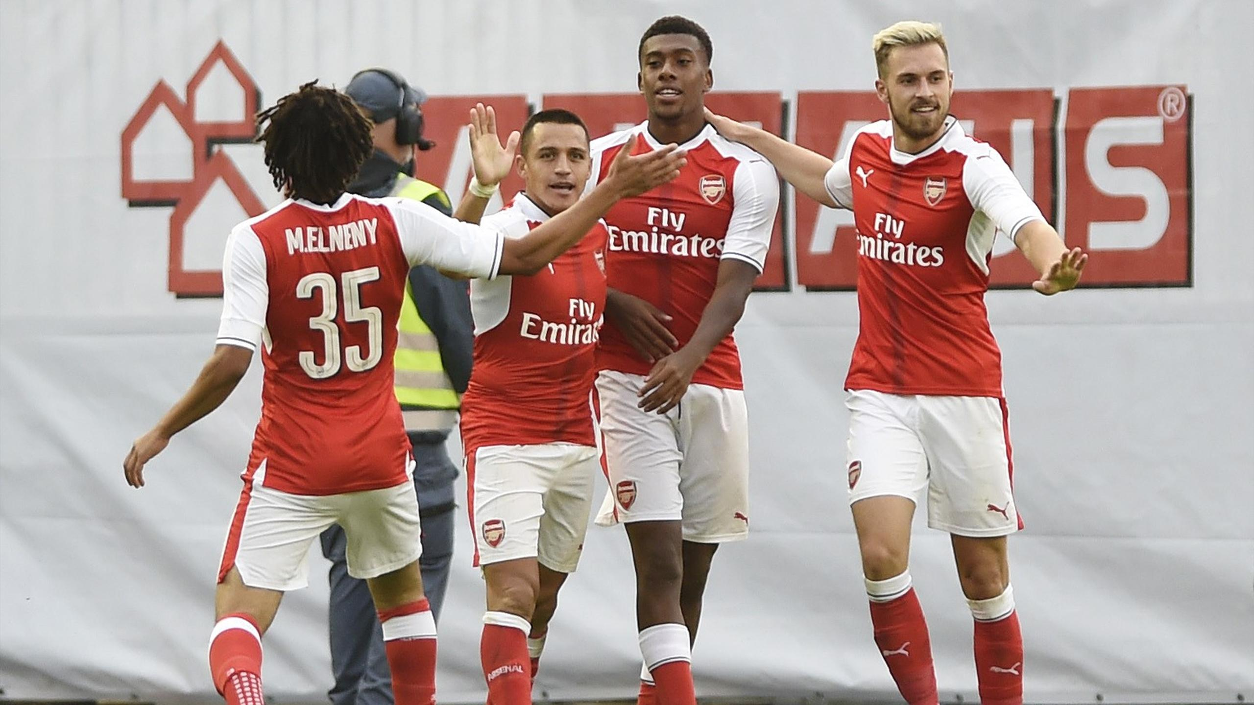 Arsenal's Alex Iwobi celebrates scoring their first goal with Alexis Sanchez, Mohamed Elneny and Aaron Ramsey