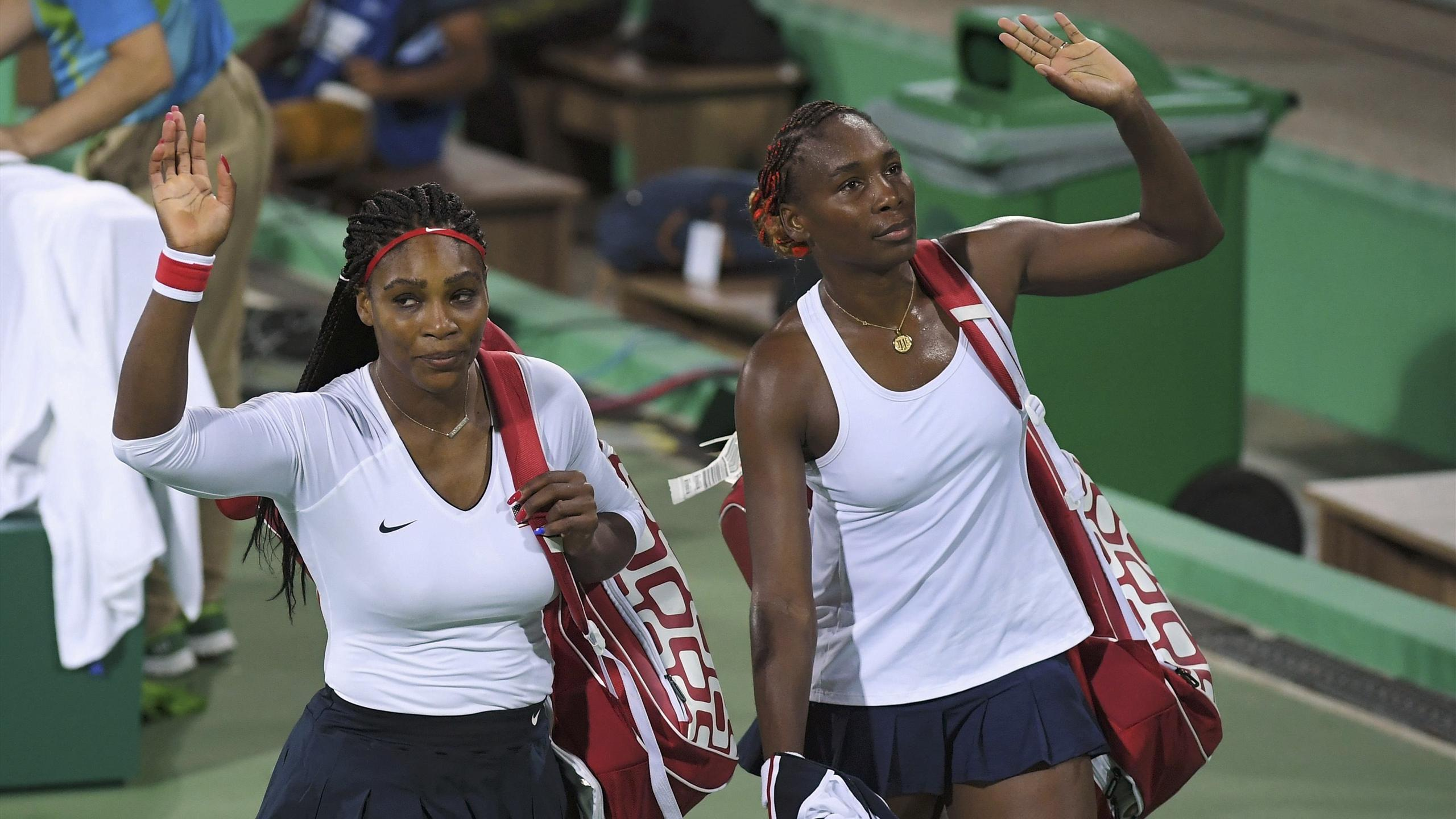 Serena Williams (USA) of USA and Venus Williams (USA) of USA leave after losing their match against Lucie Safarova (CZE) of Czech Republic and Barbora Strycova (CZE) of Czech Republic