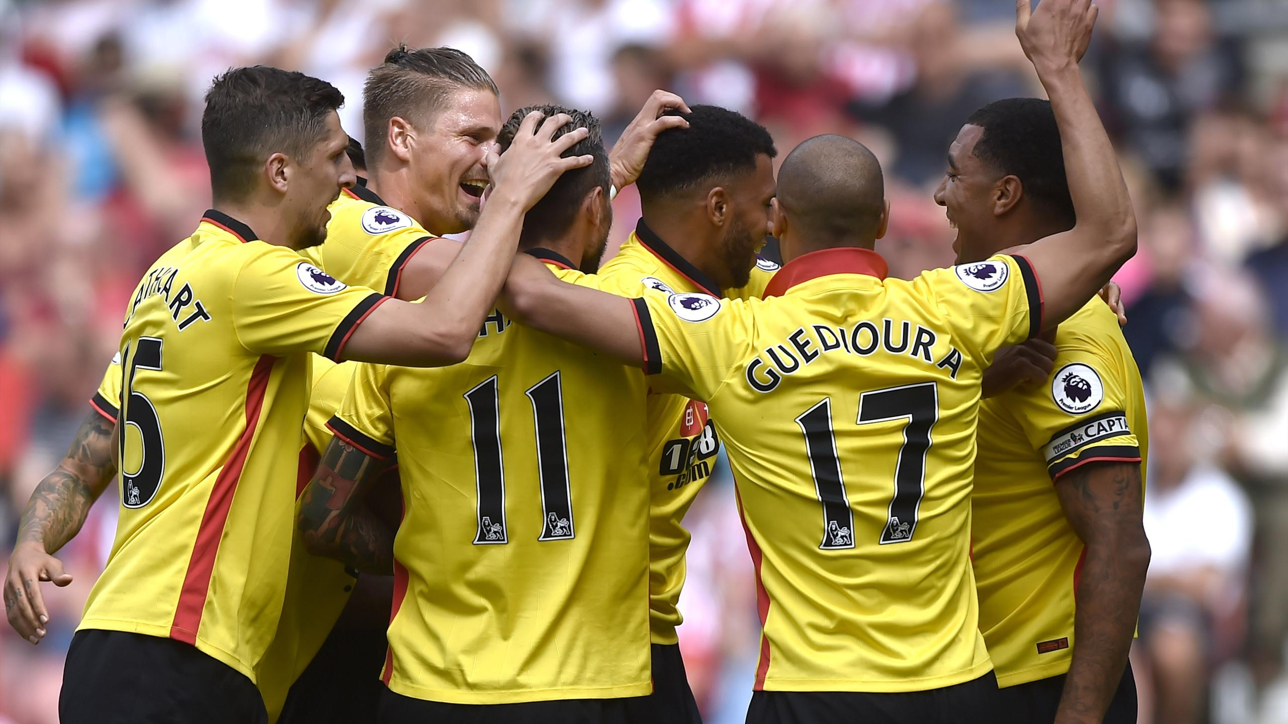 Watford's Etienne Capoue celebrates scoring their first goal with teammates