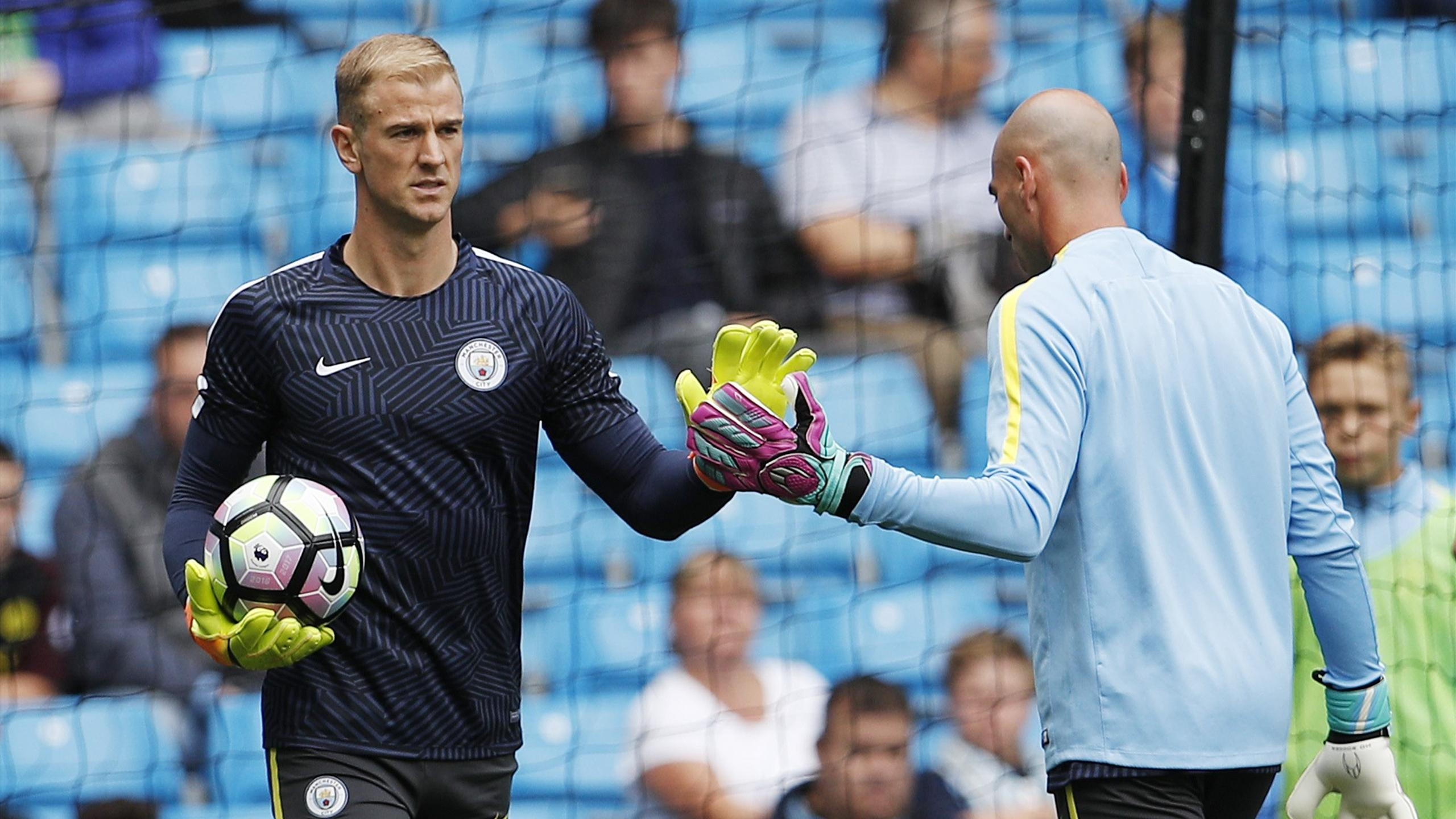 Manchester City's Joe Hart warms up with Willy Caballero before the match