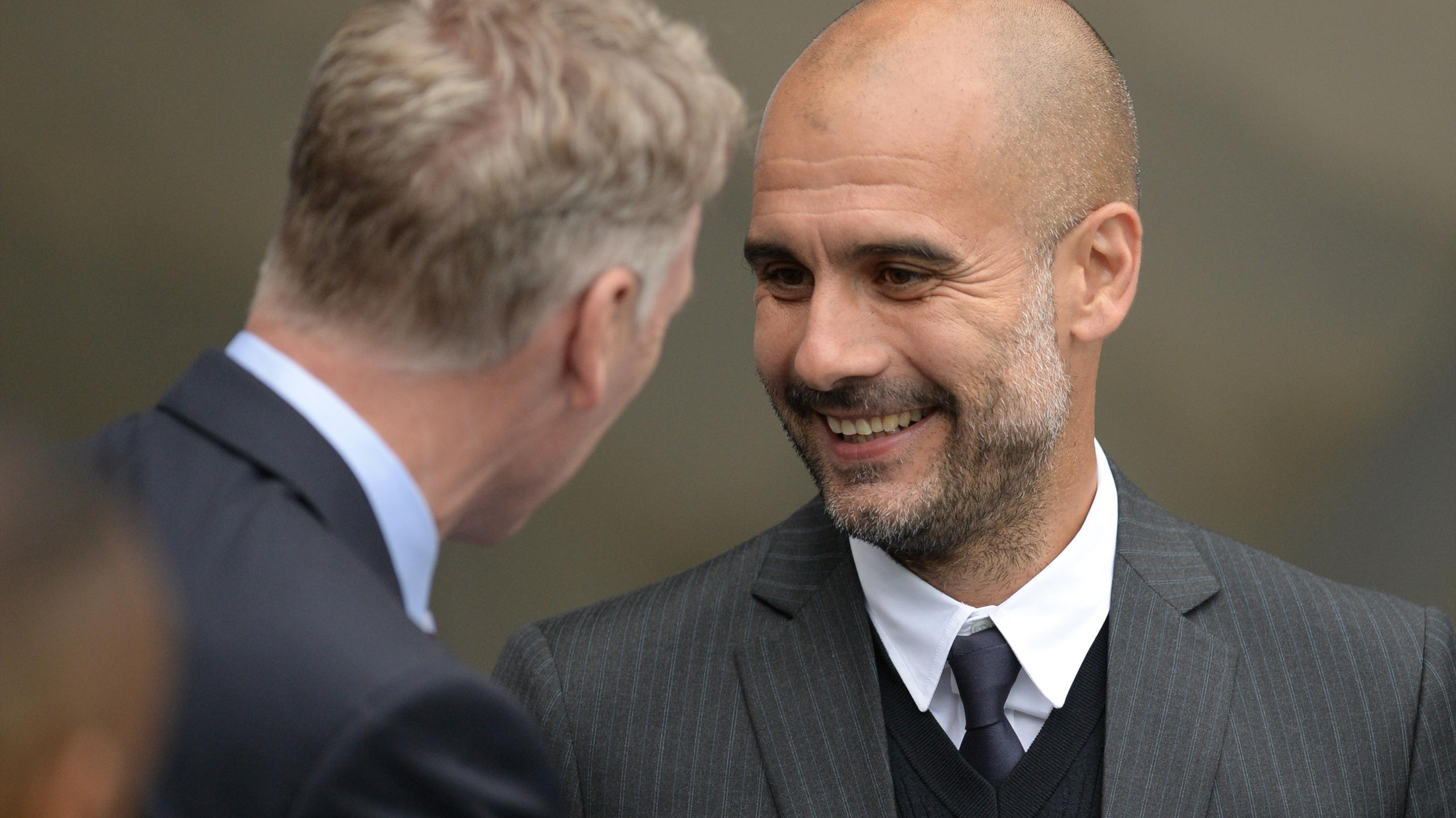Sunderland's Scottish manager David Moyes (L) is greeted by Manchester City's Spanish manager Pep Guardiola