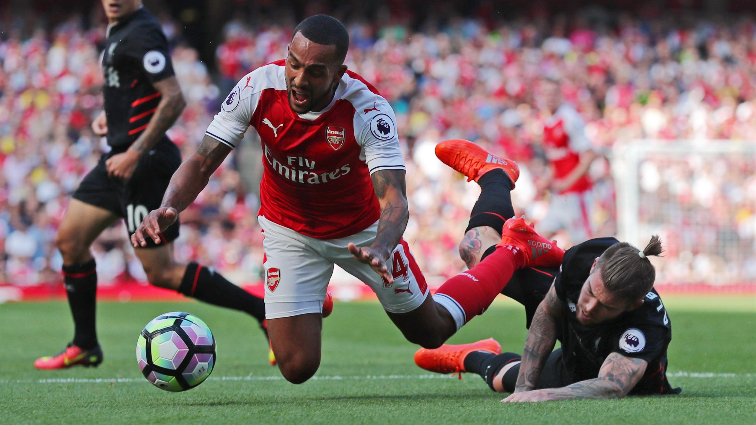 Liverpool's Alberto Moreno concedes a penalty against Arsenal's Theo Walcott
