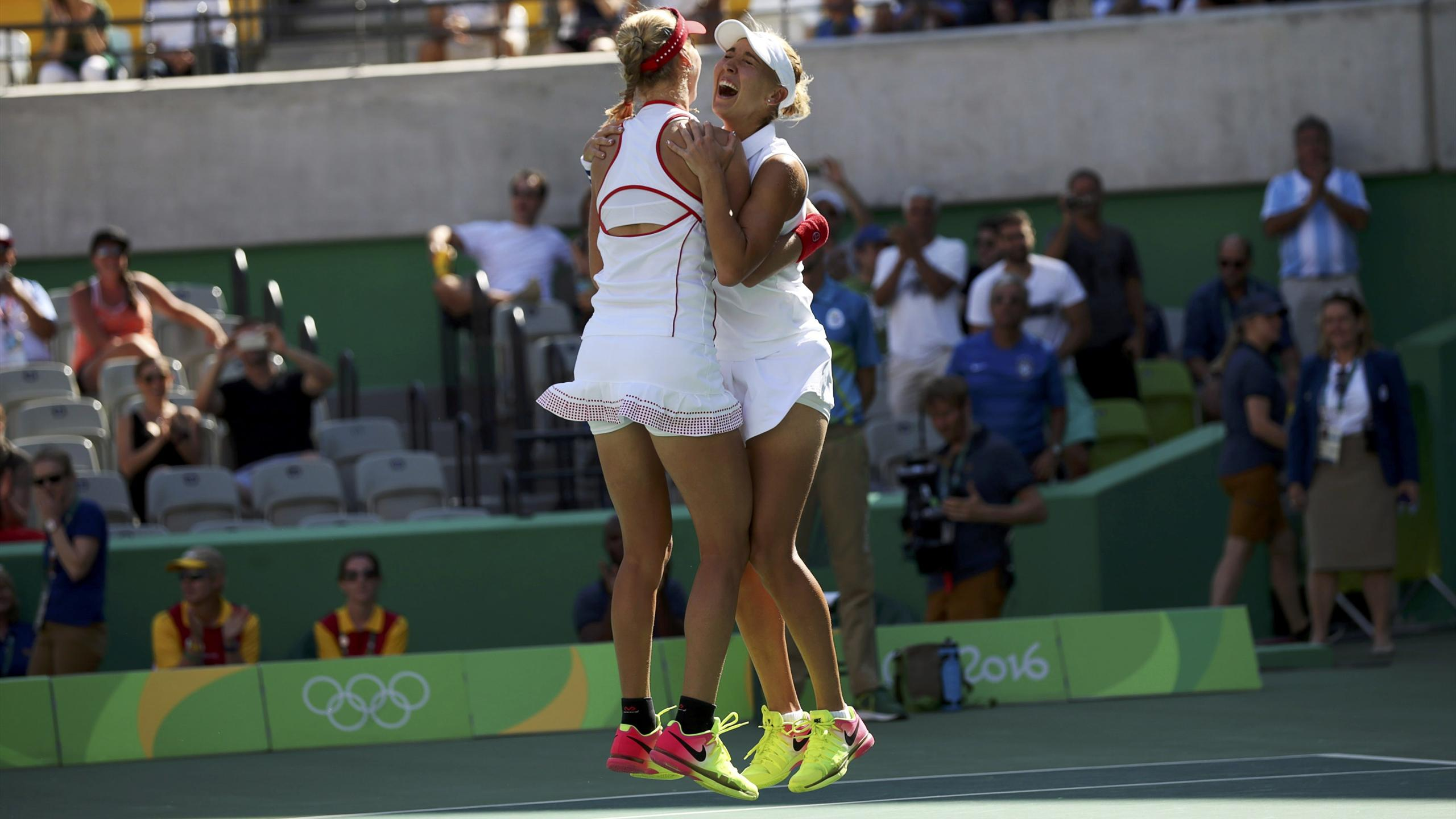 Elena Vesnina (RUS) of Russia and Ekaterina Makarova (RUS) of Russia celebrate after winning their match against Martina Hingis (SUI) of Switzerland and Timea Bacsinszky (SUI) of Switzerland