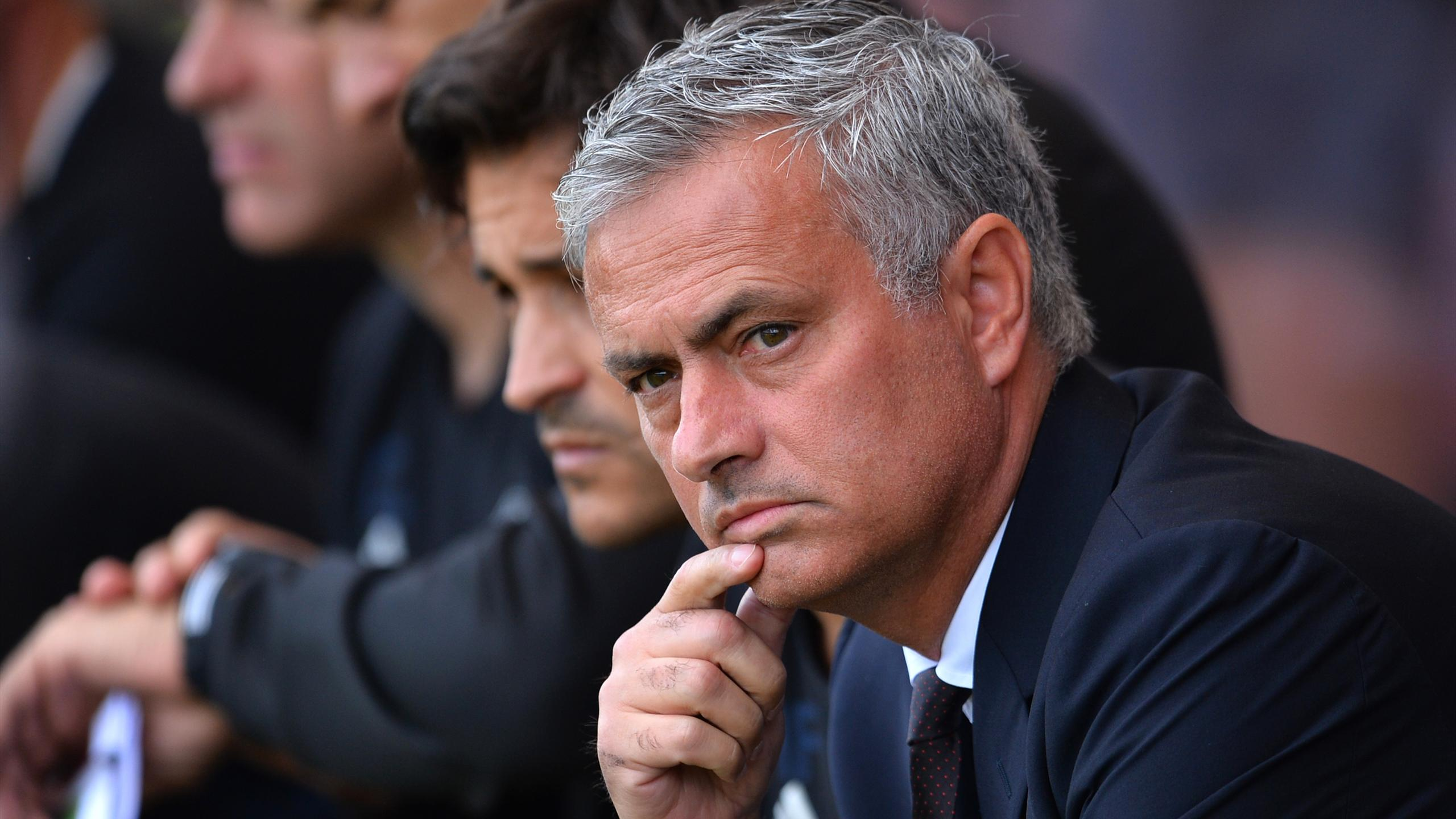 Manchester United's Portuguese manager Jose Mourinho takes his seat for the English Premier League football match between Bournemouth and Manchester United at the Vitality Stadium in Bournemouth, southern England on August 14, 2016.