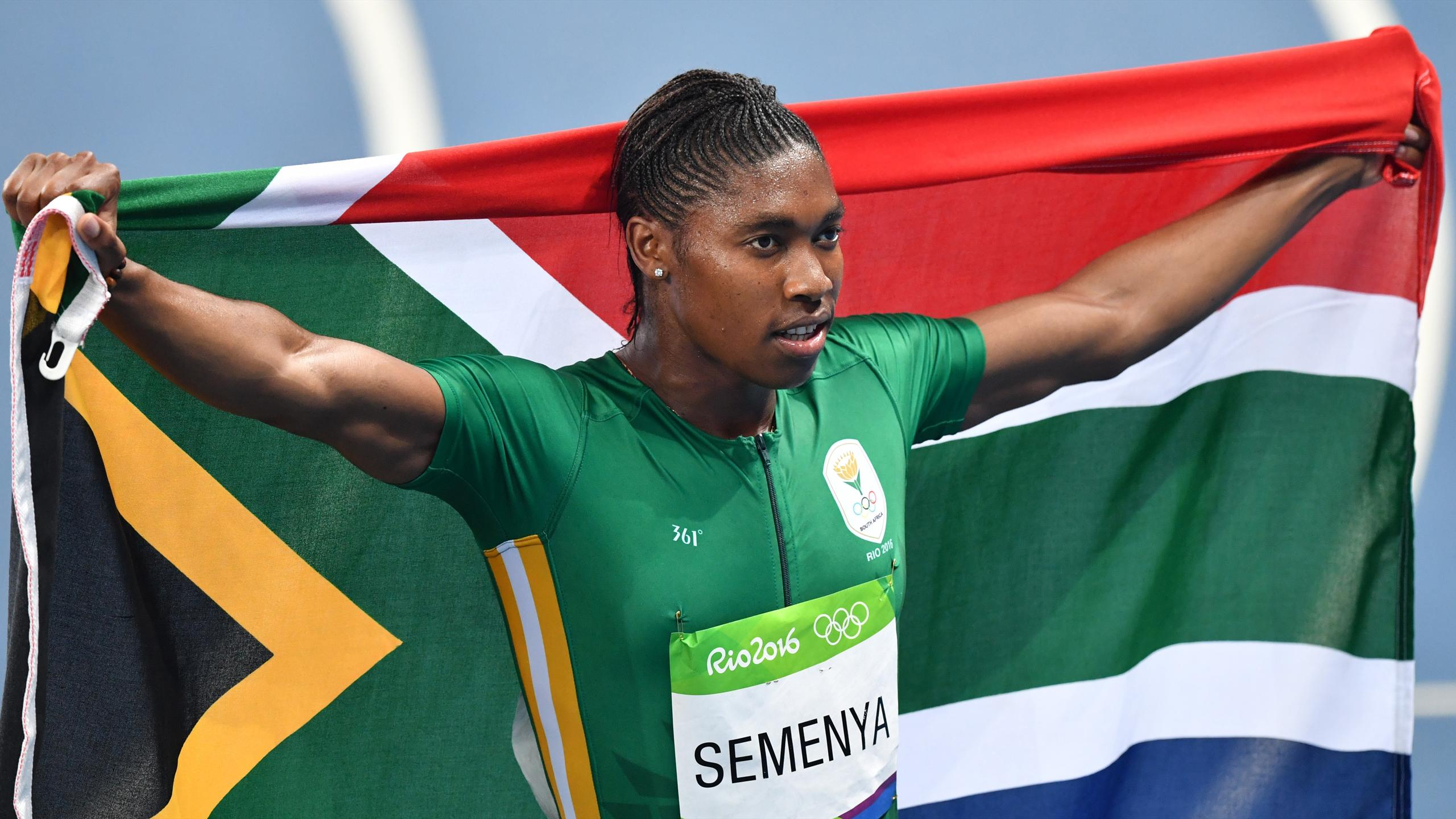 South Africa's Caster Semenya holds her national flag as she celebrates winning the Women's 800m Final during the athletics event at the Rio 2016 Olympic Games
