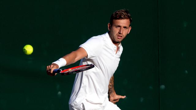 Wawrinka saves match point to beat unseeded Evans