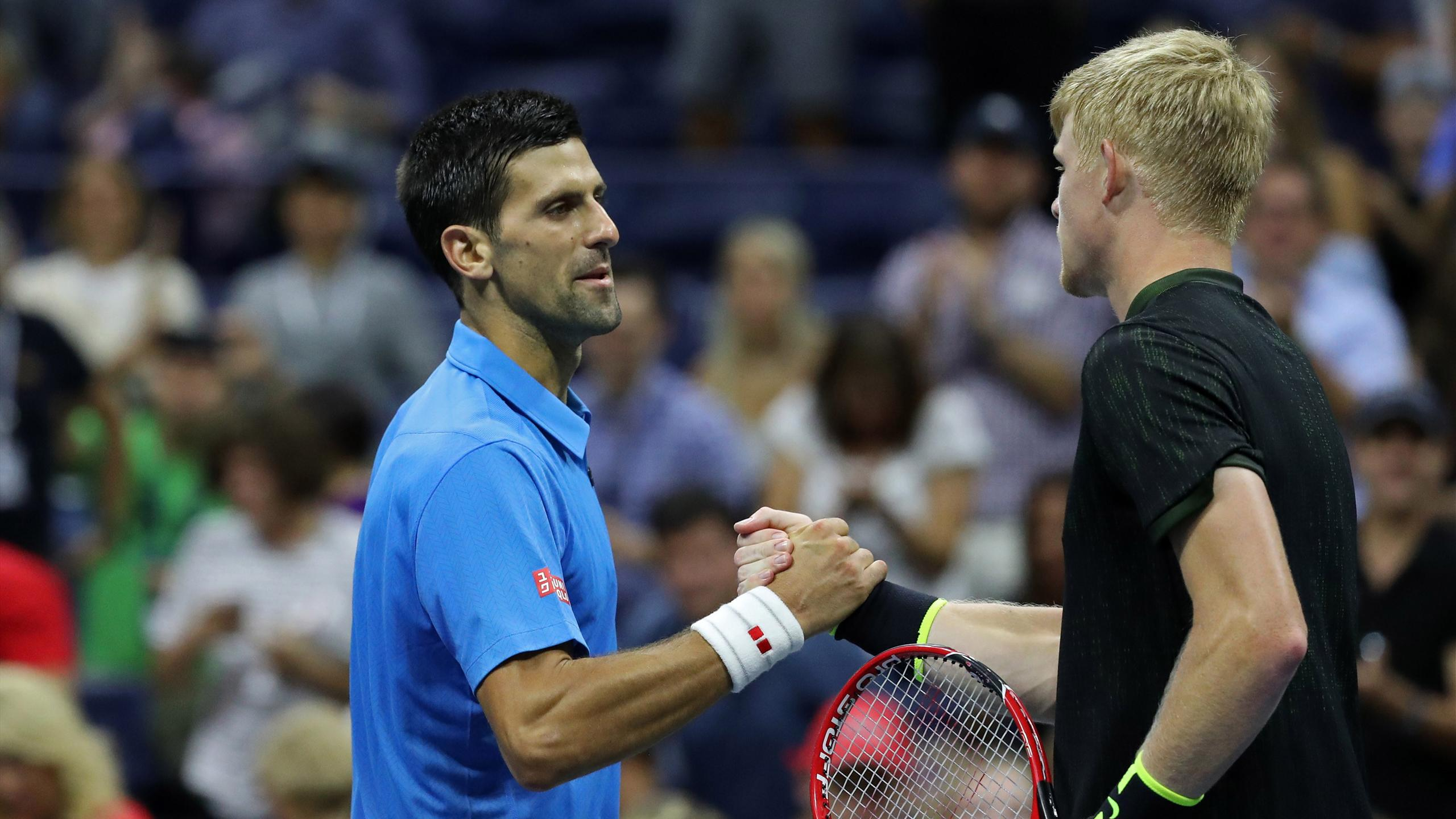 Novak Djokovic of Serbia (L) shakes hands with Kyle Edmund of Great Britain (R) after their match on day seven of the 2016 U.S. Open tennis tournament at USTA Billie Jean King National Tennis Center