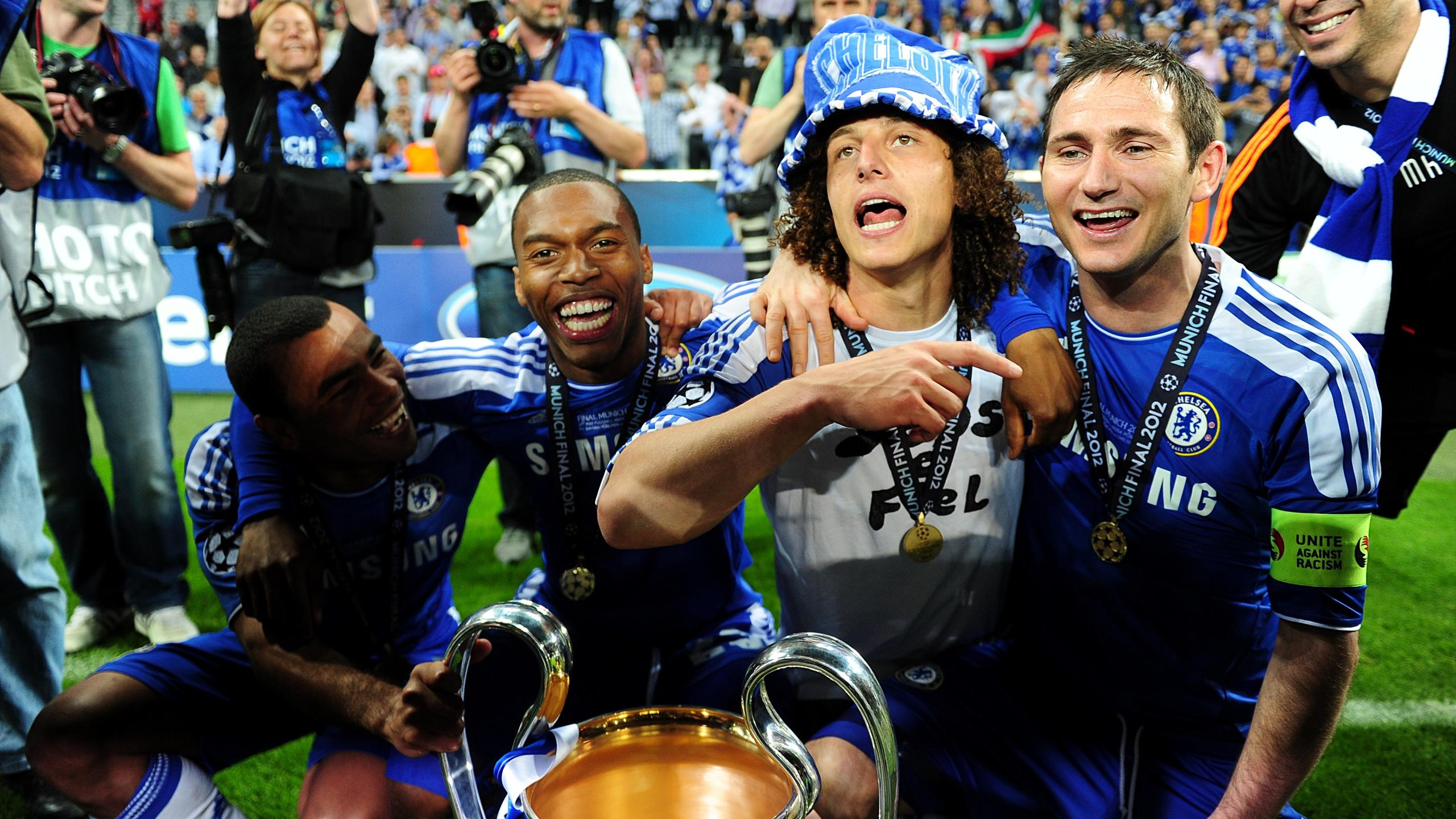 (L-R) Chelsea's Ashley Cole, Daniel Sturridge, David Luiz and Frank Lampard celebrate with the UEFA Champions League trophy after the game