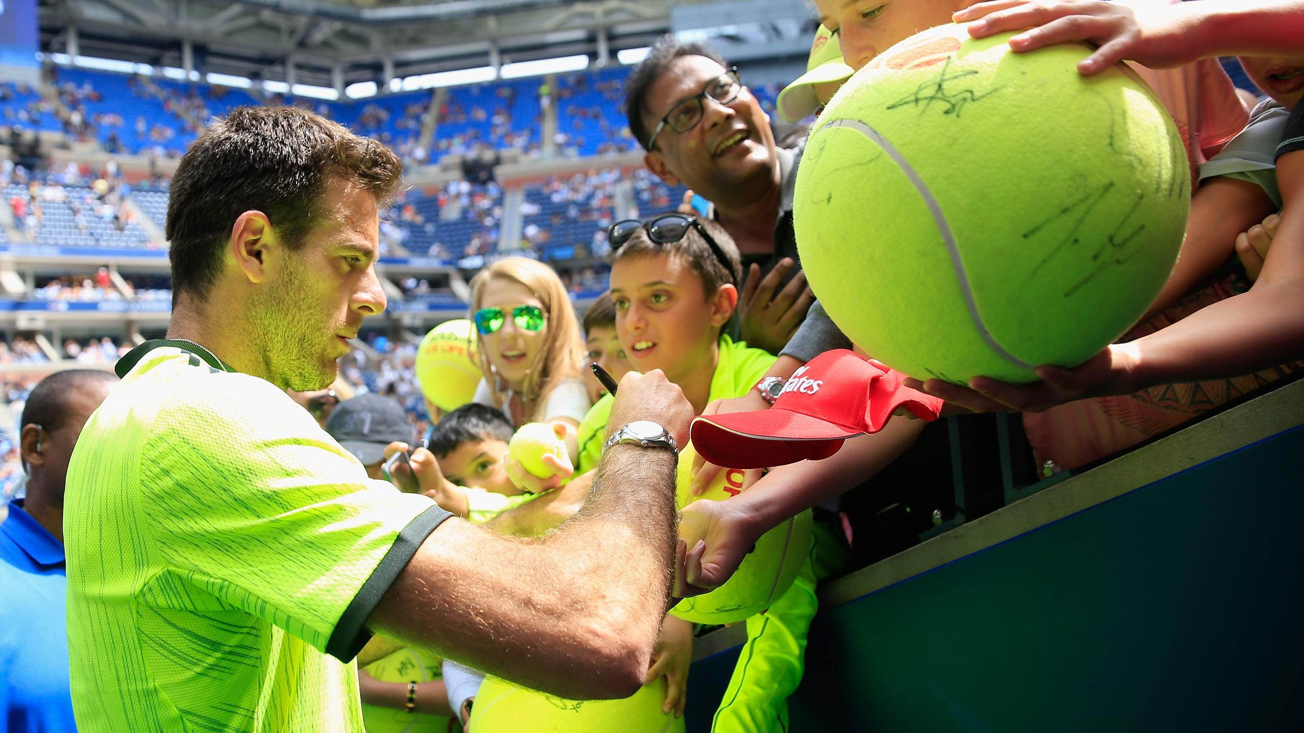 Juan Martín del Potro of Argentina signs his autograph for fans