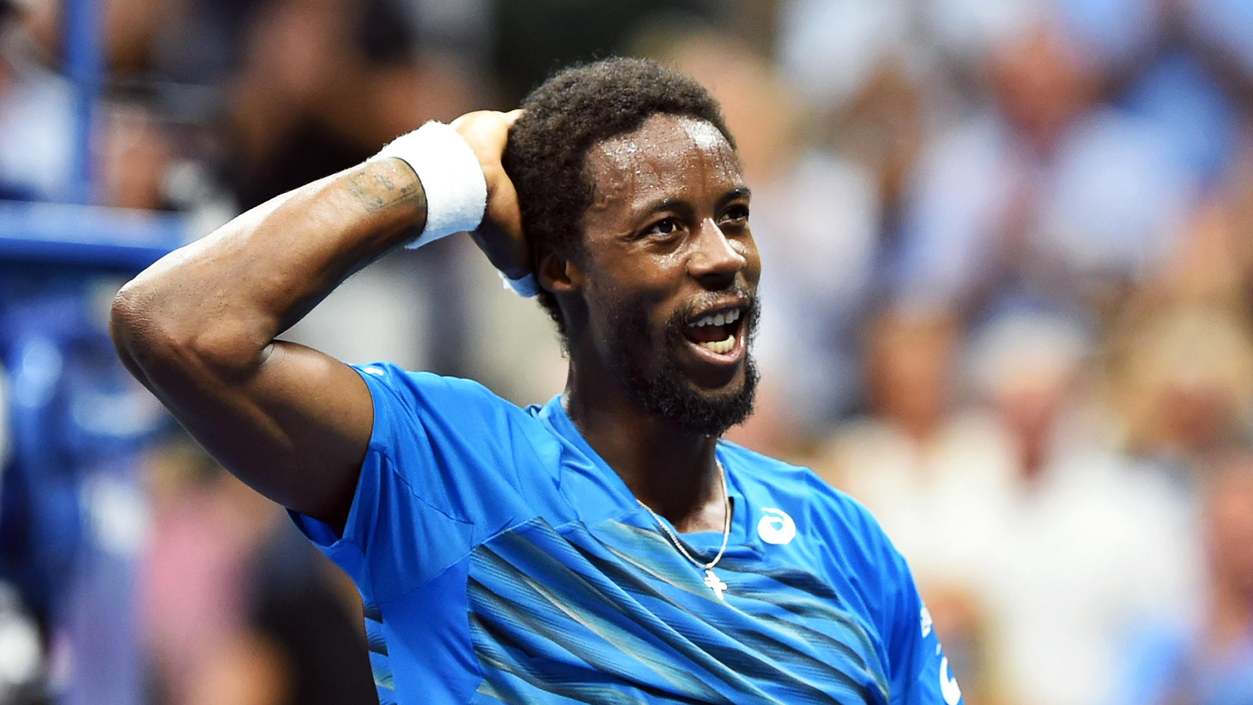 Gael Monfils of France reacts after defeating his compatriot Lucas Pouille