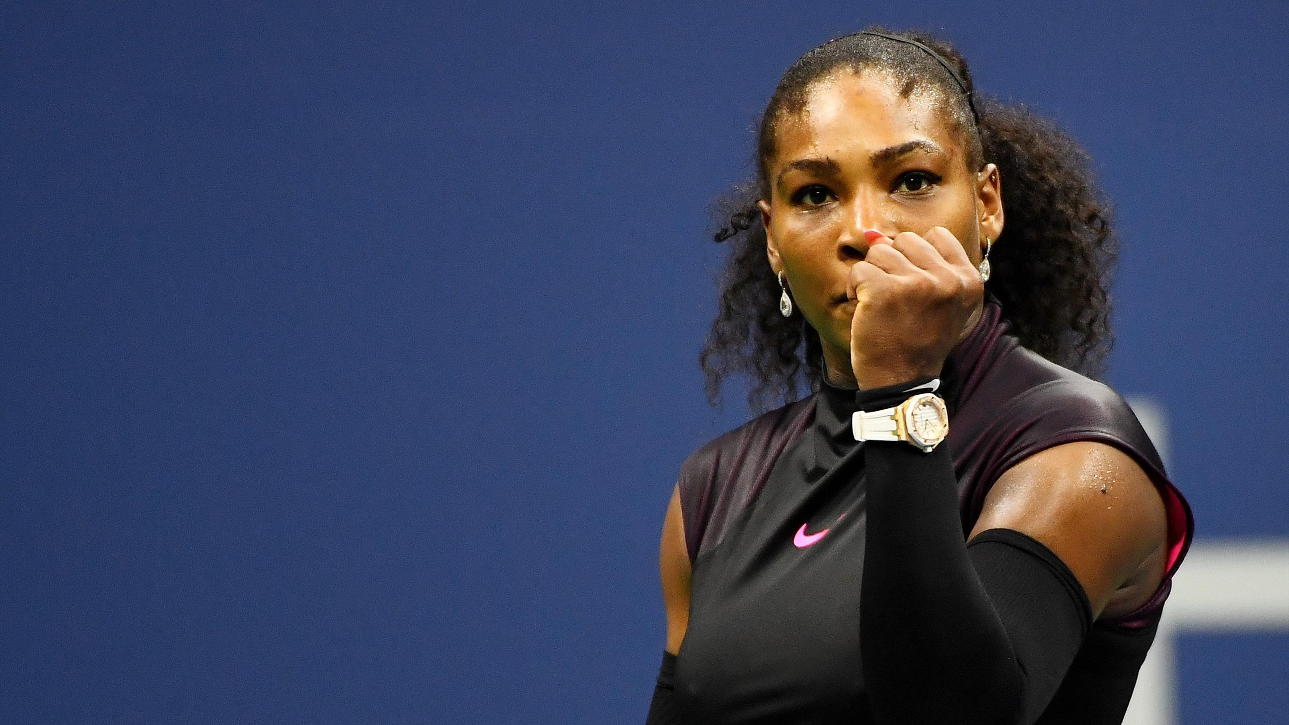 Serena Williams of the United States celebrates defeating Simona Halep