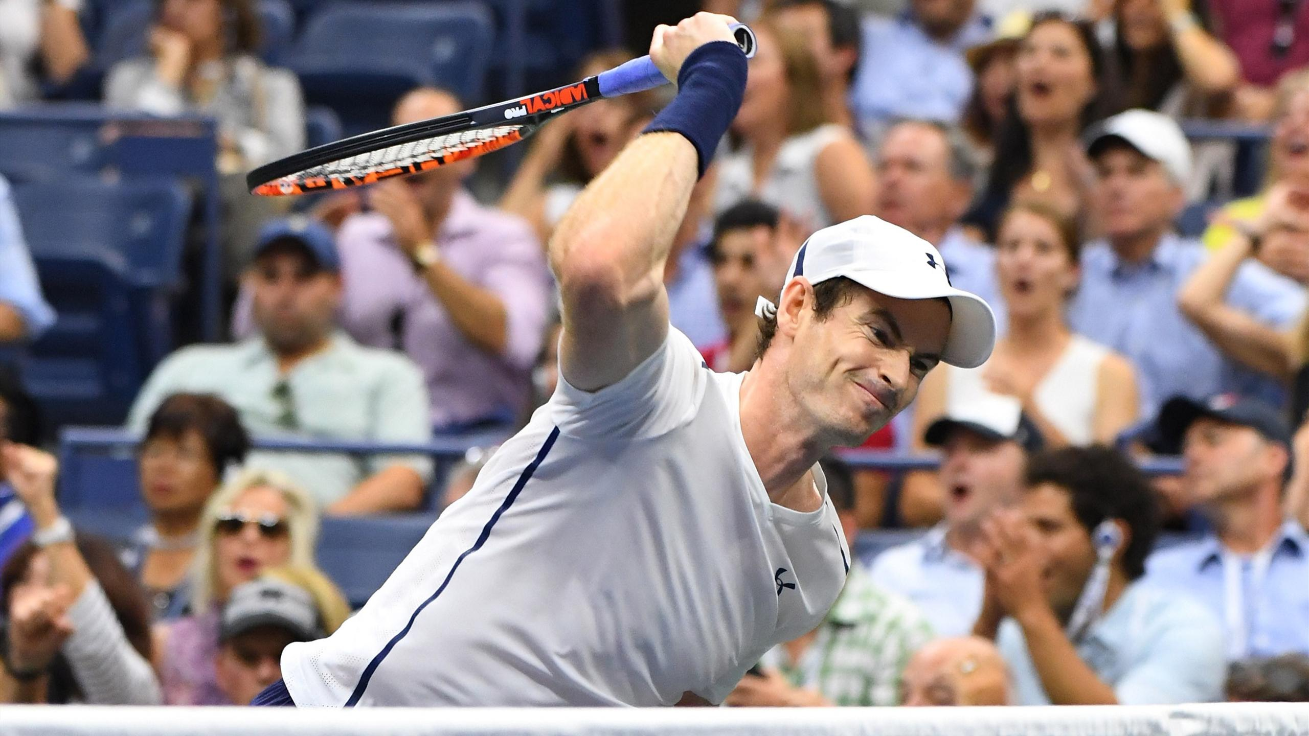 Andy Murray of Great Britain reacts to being broken in the 5th set while playing Kei Nishikori