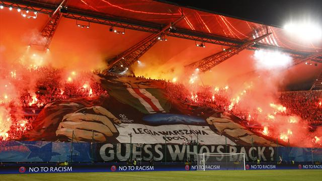 Legia Warsaw fans clash with Madrid police