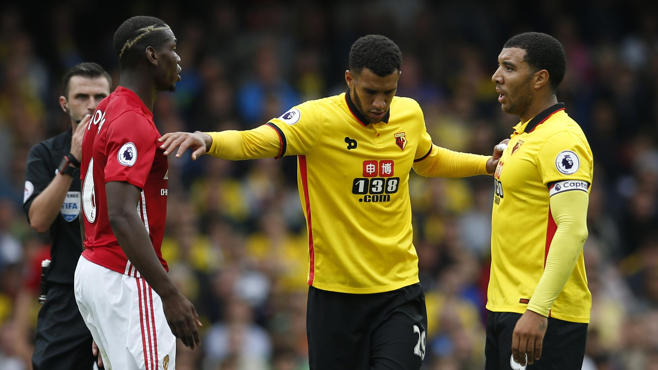 Manchester United's Paul Pogba clashes with Watford's Troy Deeney as Etienne Capoue interjects