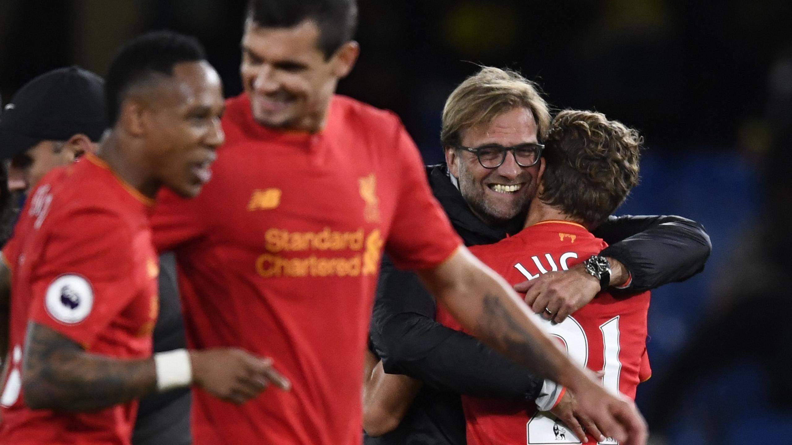 Liverpool manager Juergen Klopp celebrates with Lucas Leiva after the game