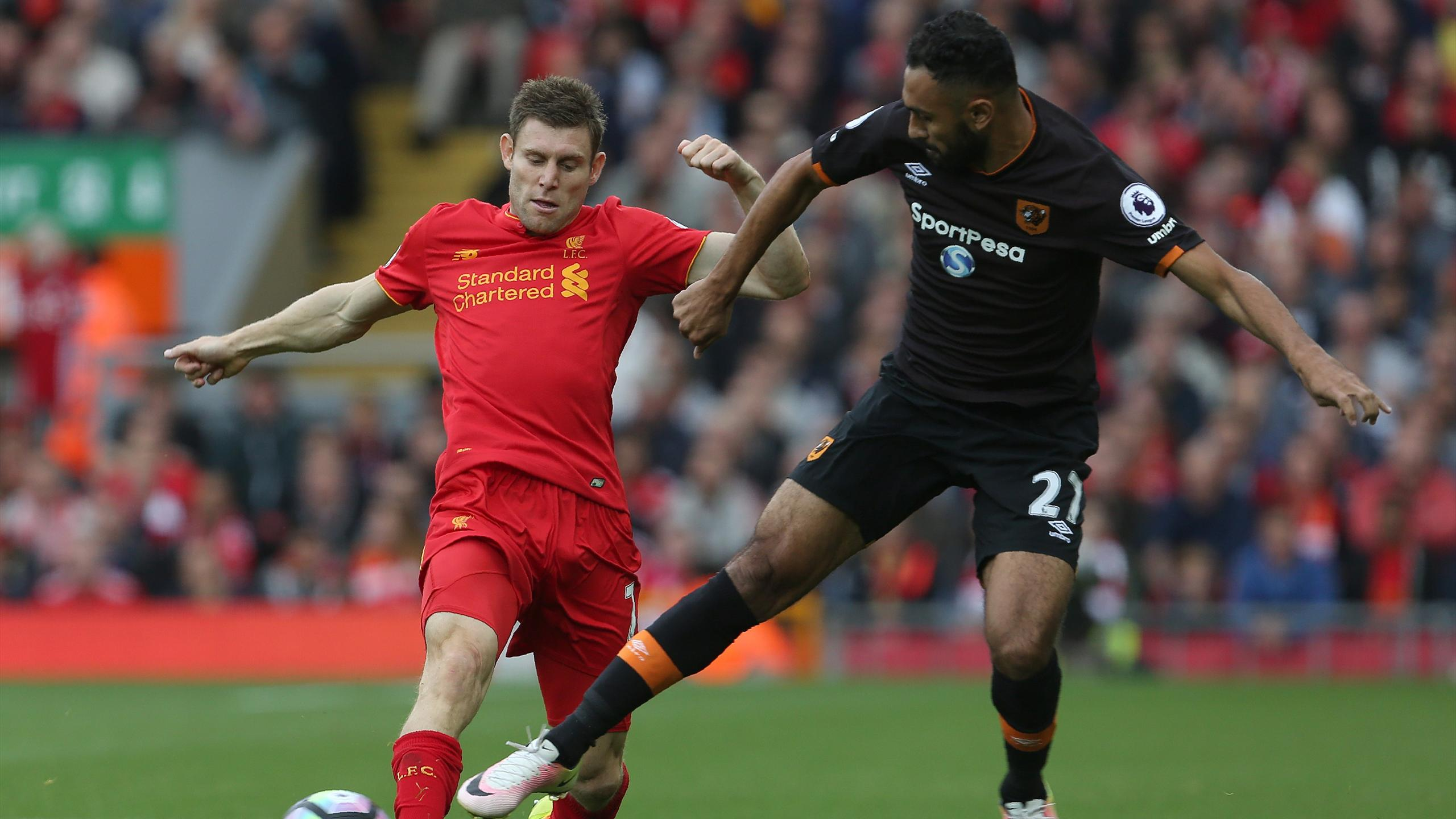 Liverpool's English midfielder James Milner (L) vies with Hull City's Egyptian midfielder Ahmed Elmohamady