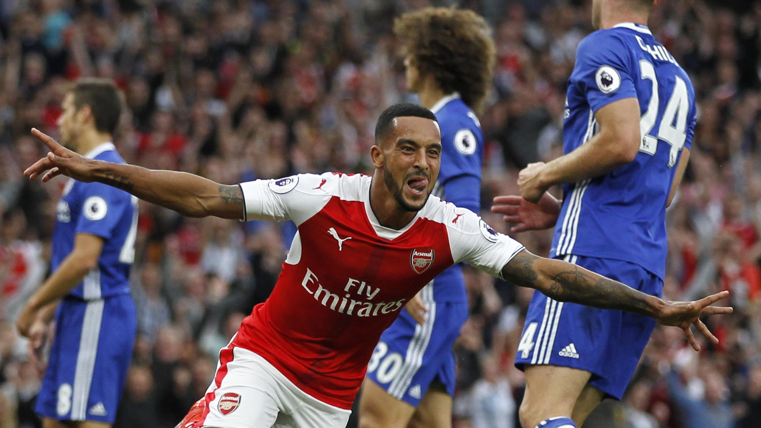 Arsenal's English midfielder Theo Walcott celebrates scoring their second goal
