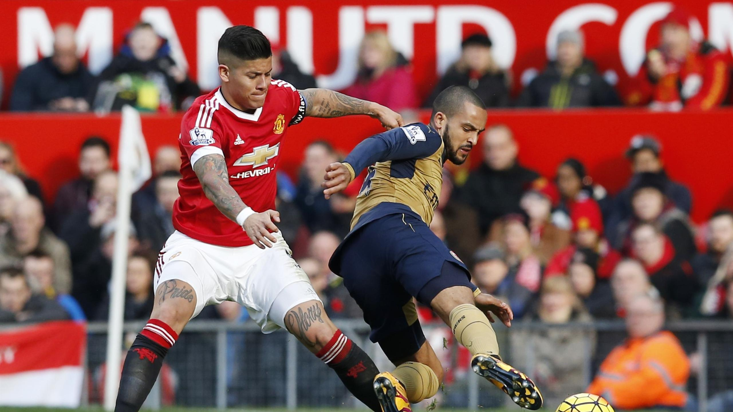 Manchester United's Marcos Rojo and Arsenal's Theo Walcott in action
