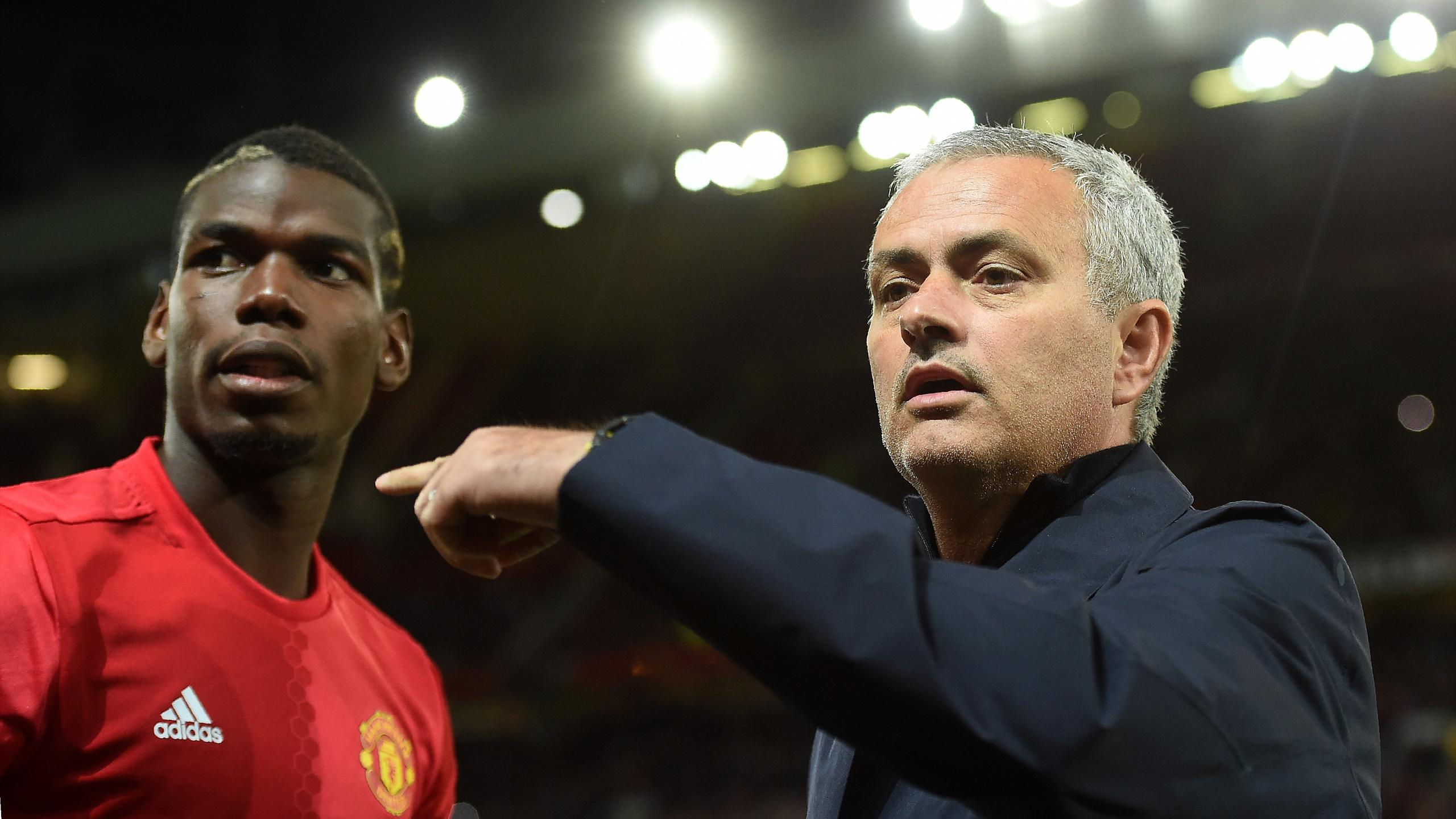 Manchester United's Portuguese manager Jose Mourinho (R) gestures to Manchester United's French midfielder Paul Pogba