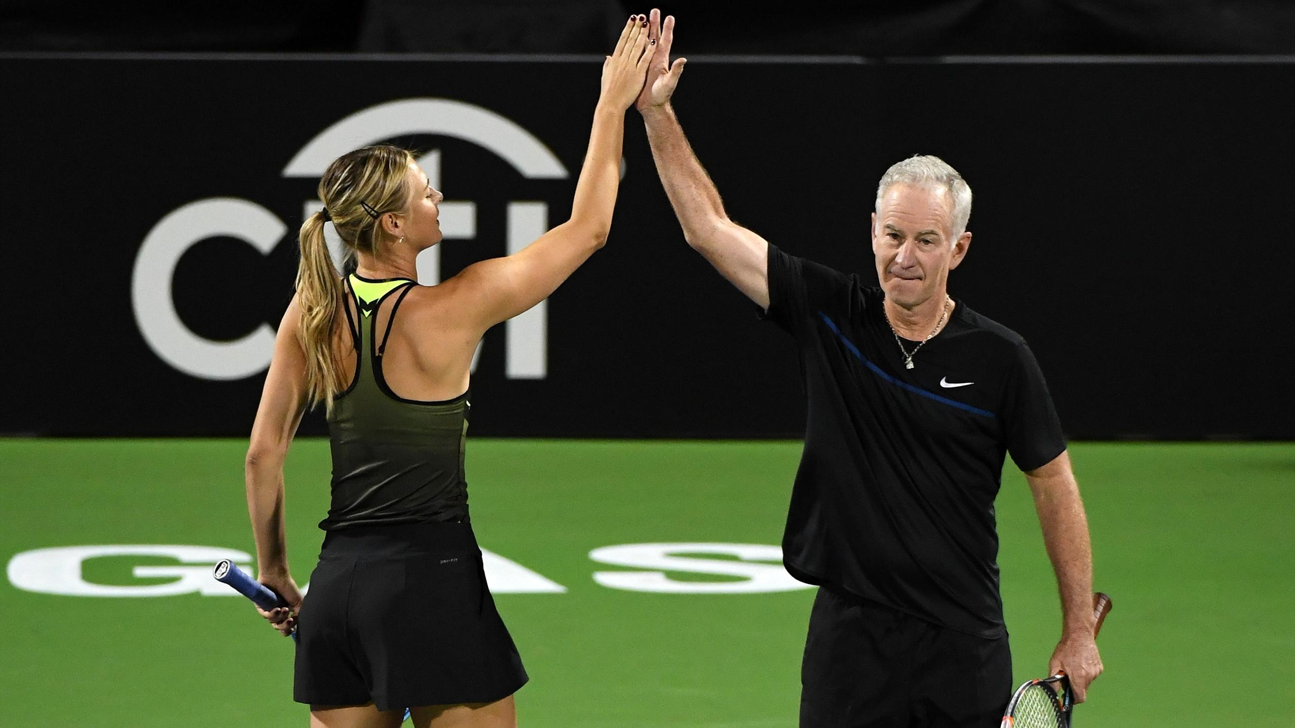 Maria Sharapova celebrates with John McEnroe at the World TeamTennis Smash Hits charity tennis event benefiting the Elton John AIDS Foundation at Caesars Palace on October 10, 2016 in Las Vegas, Nevada