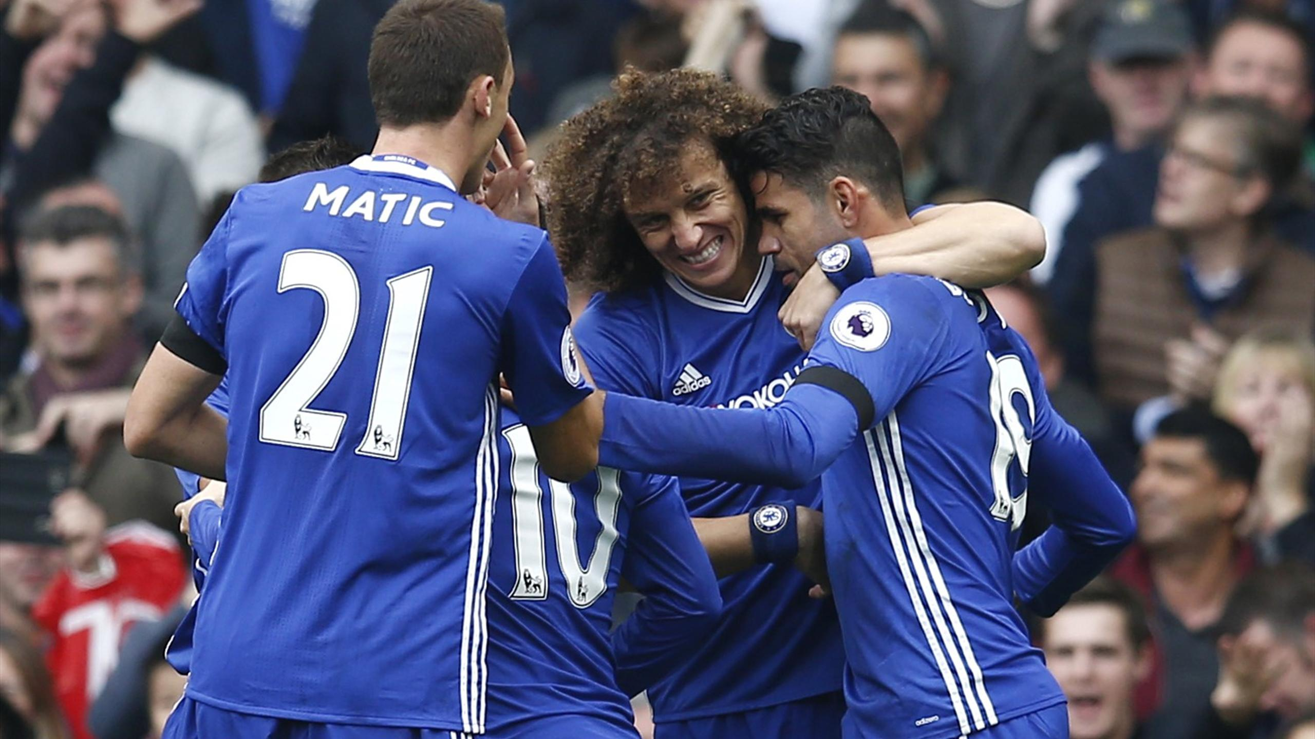 Chelsea's Diego Costa celebrates scoring their first goal with David Luiz and Nemanja Matic