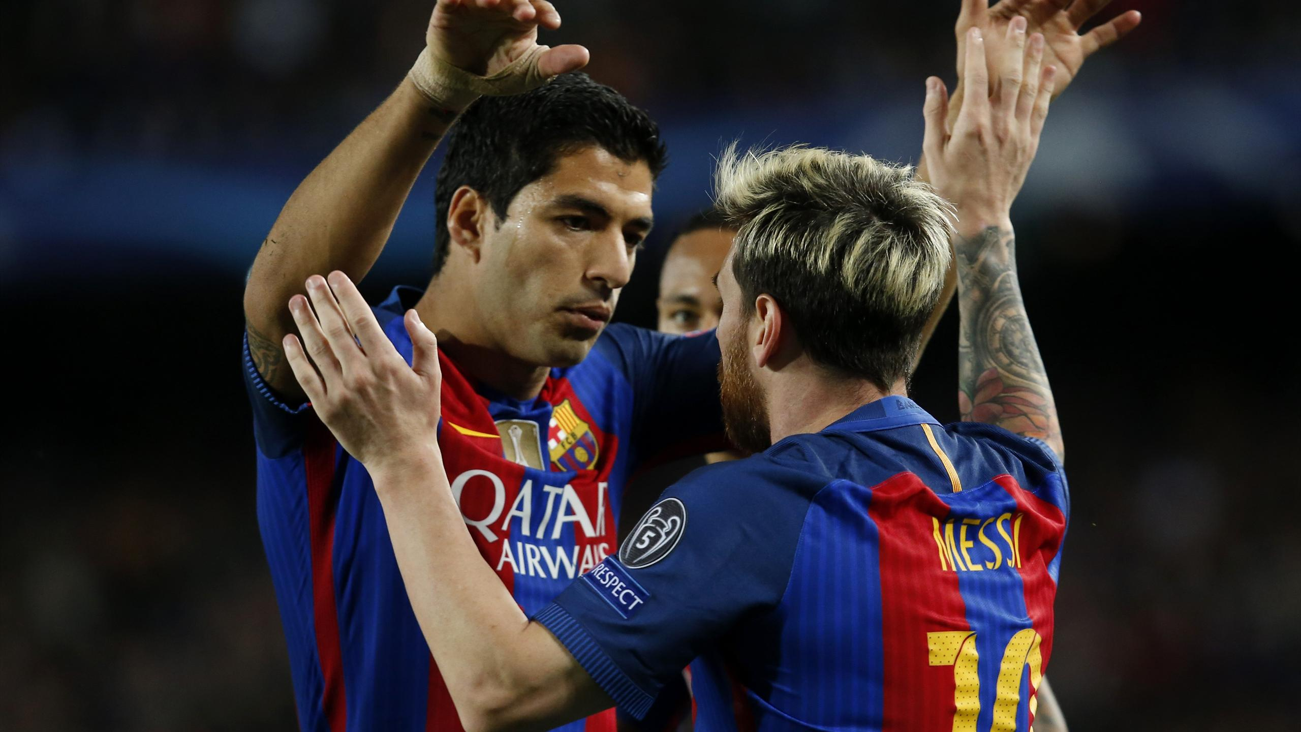 Barcelona's Argentinian forward Lionel Messi celebrates with Luis Suarez during their Champions League clash against Manchester City at the Camp Nou