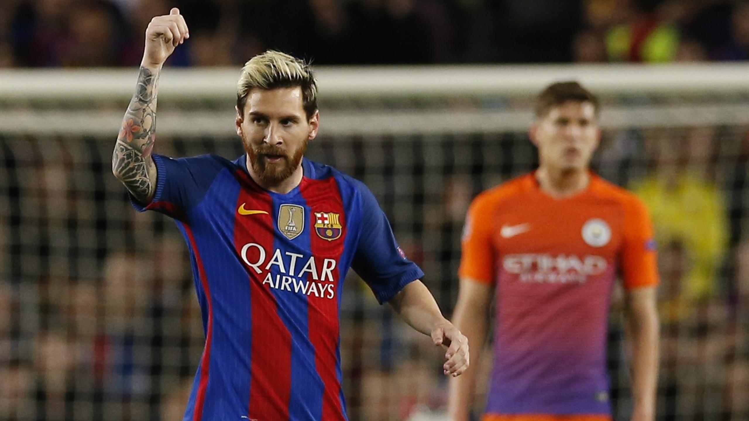 Barcelona's Lionel Messi celebrates scoring their first goal against Manchester City