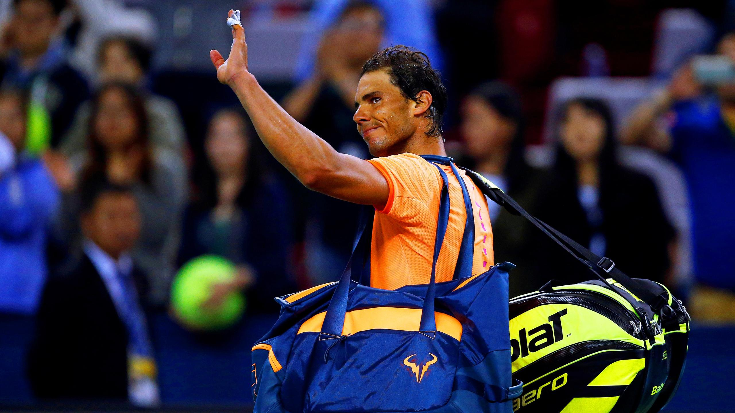 Rafael Nadal of Spain leaves the court after losing at the Shanghai Masters