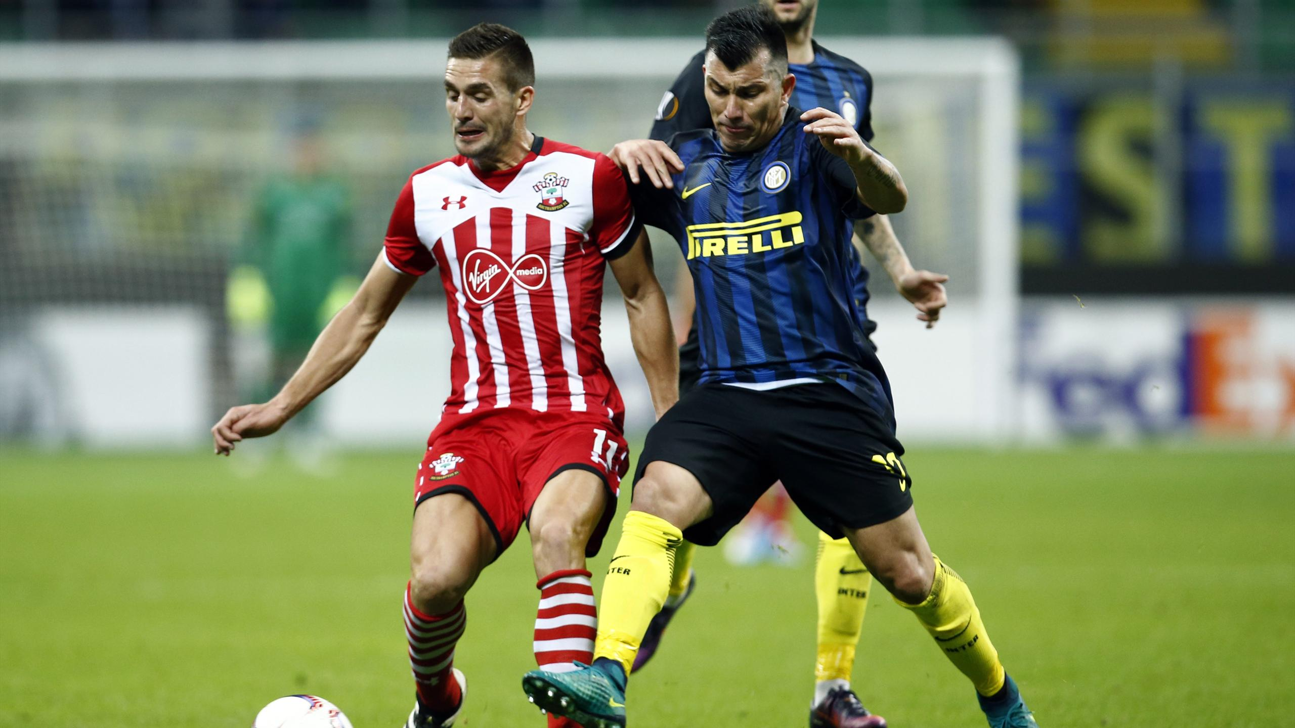 Southampton's Dusan Tadic in action with Inter Milan's Gary Medel