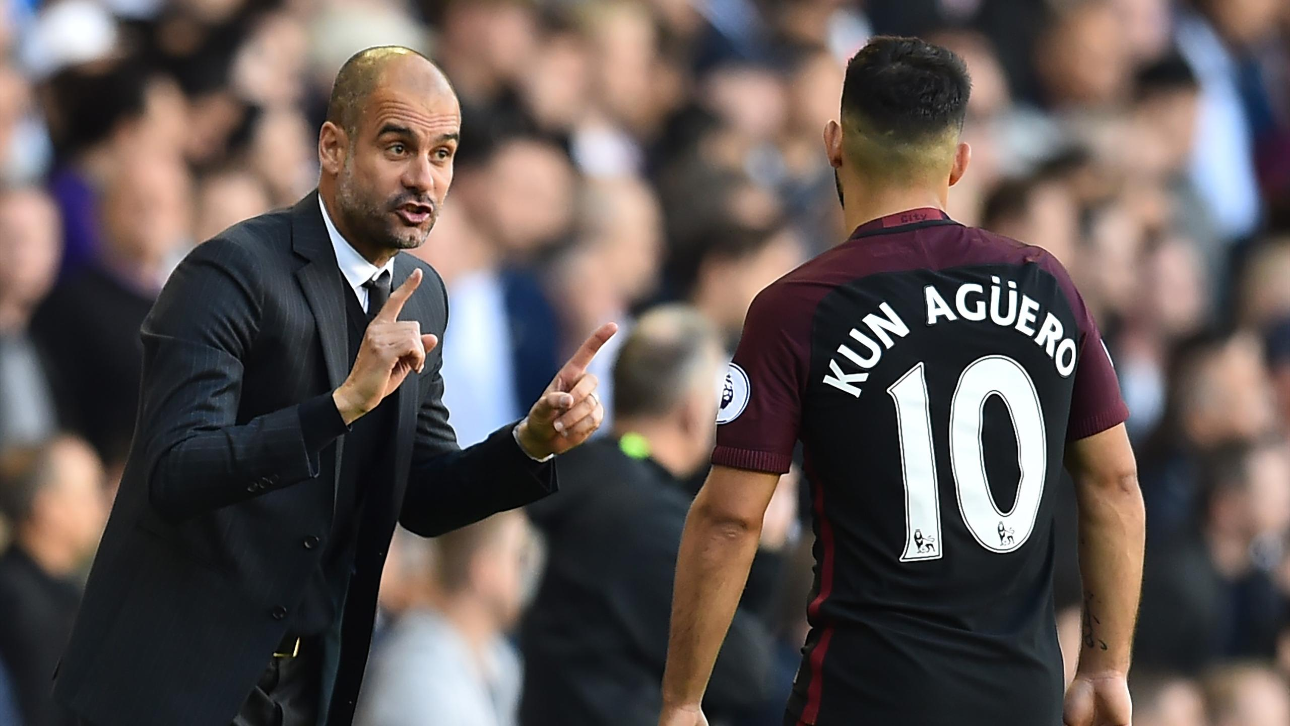 Sergio Aguero and Pep Guardiola of Manchester City
