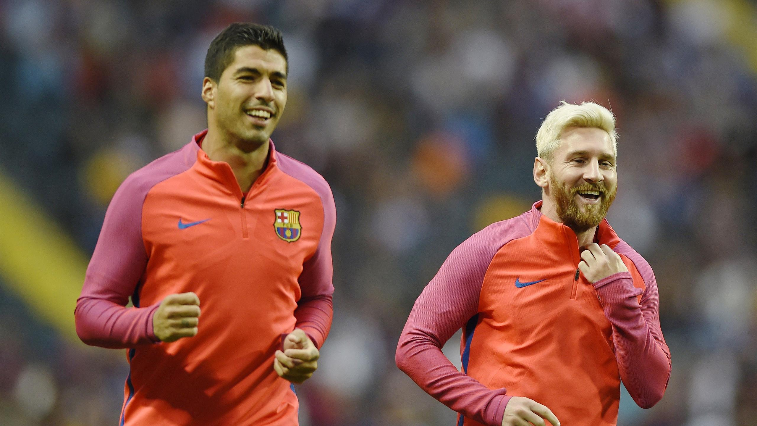Barcelona forwards Luis Suarez and Lionel Messi