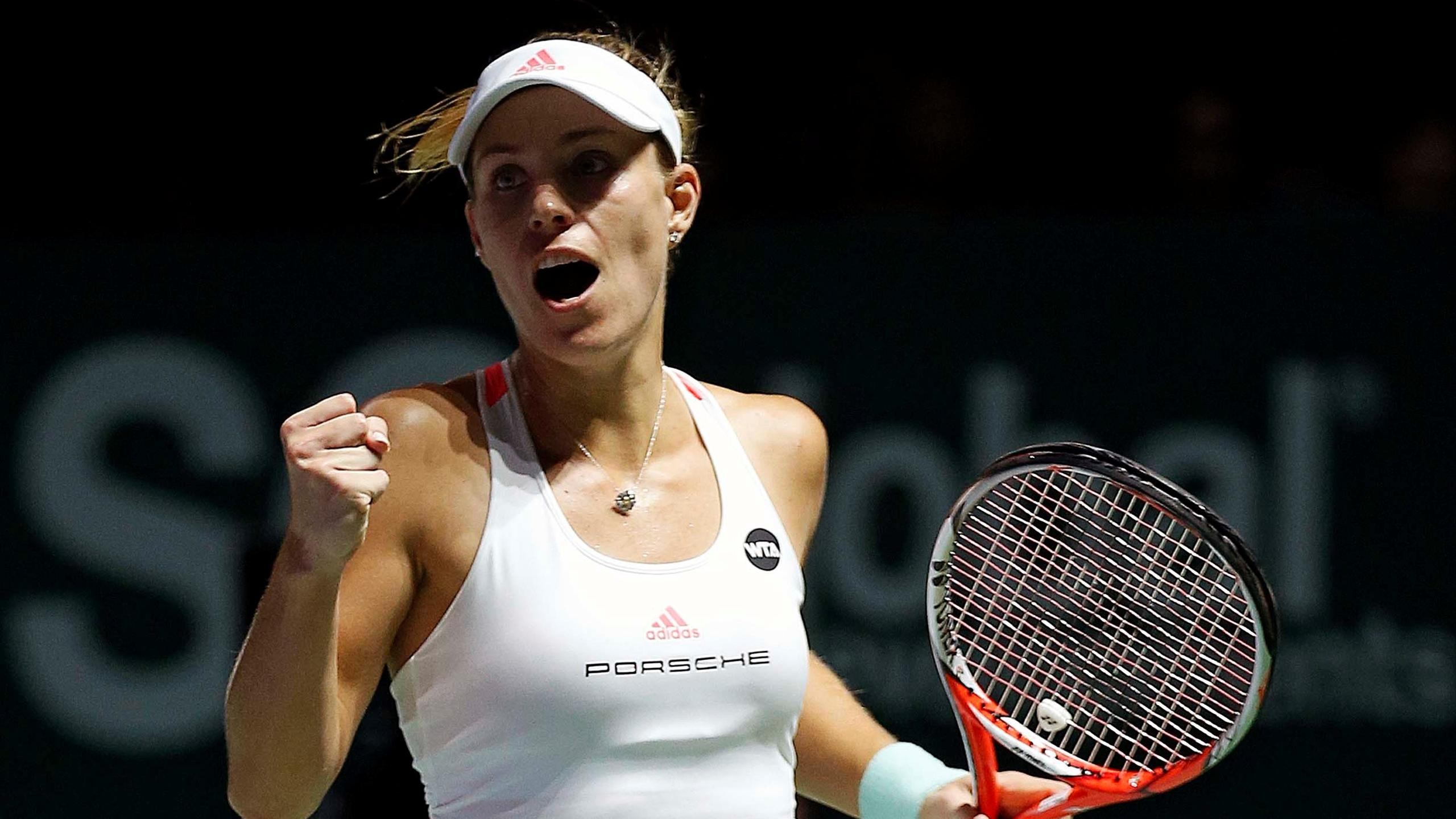 Angelique Kerber of Germany celebrates after defeating Agnieszka Radwanska of Poland