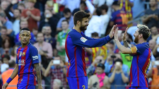 Messi and Pique return for Barcelona against Sevilla