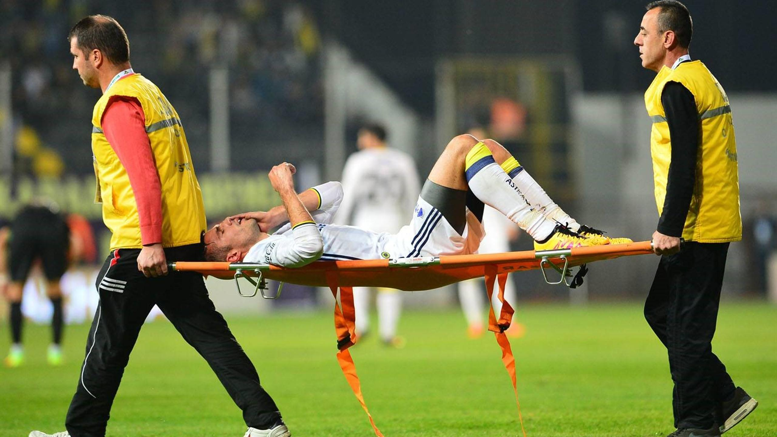 Robin van Persie goes off on a stretcher
