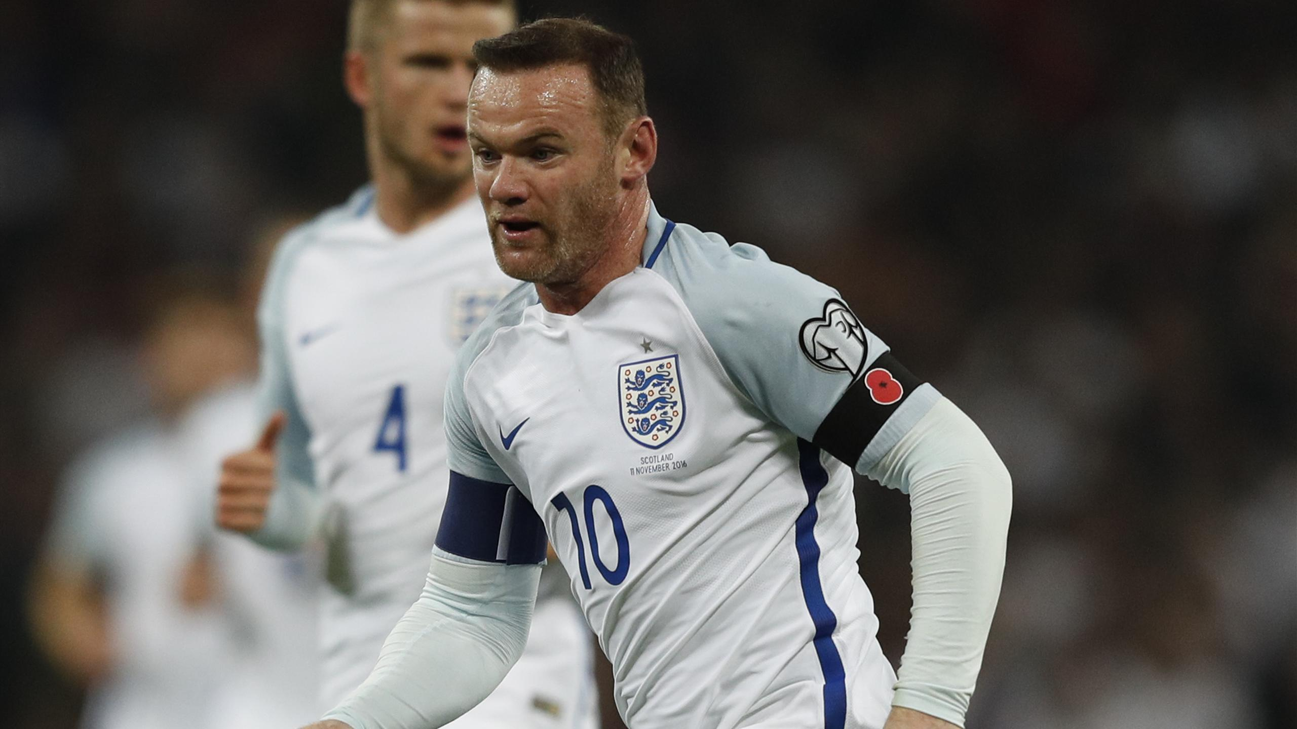 In a picture taken on November 11, 2016 England's striker Wayne Rooney wears a poppy armband to commemorate Armistice Day