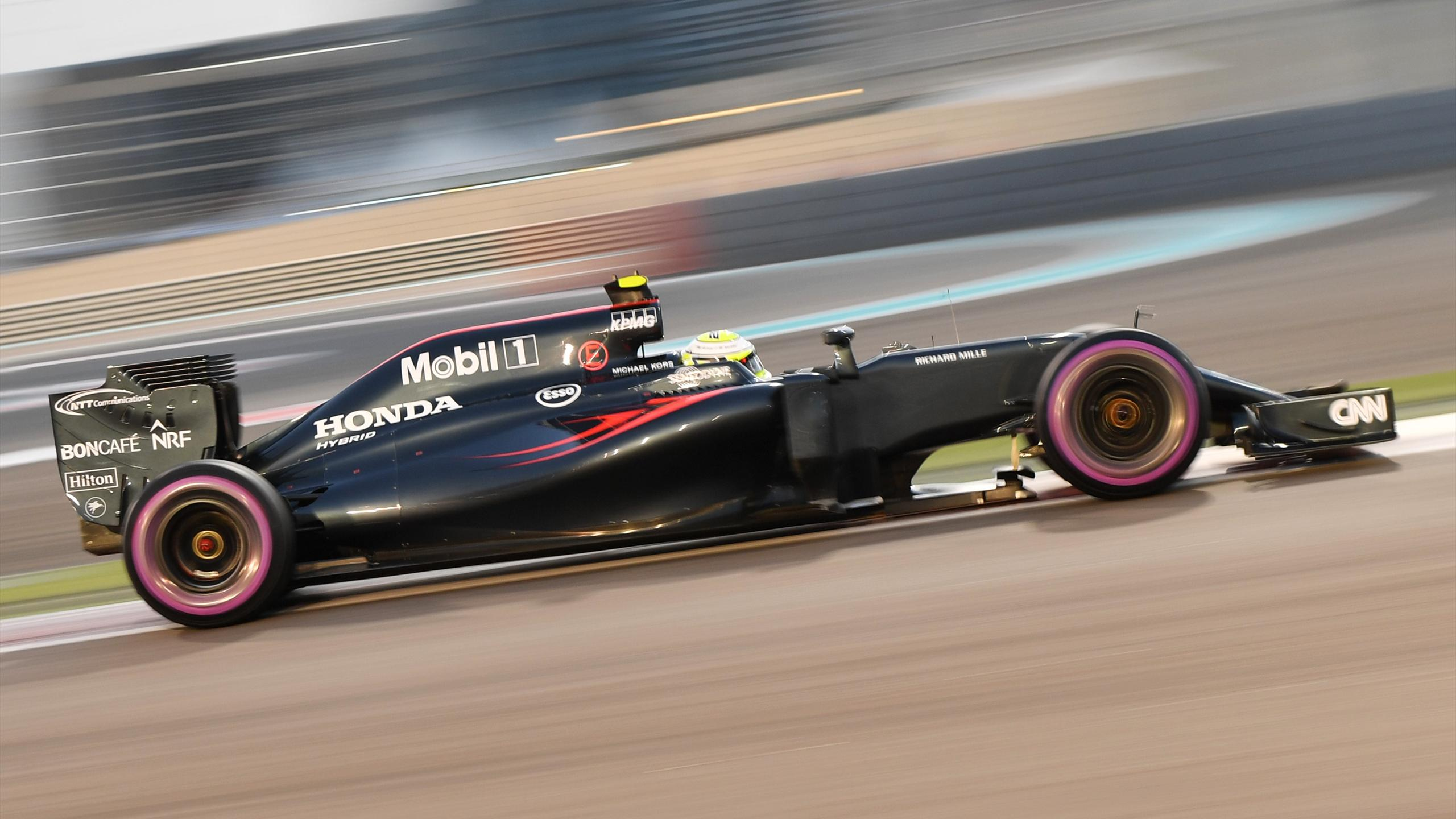 McLaren Honda's British driver Jenson Button steers his car during the qualifying session as part of the Abu Dhabi Formula One Grand Prix at the Yas Marina circuit on November 26, 2016.