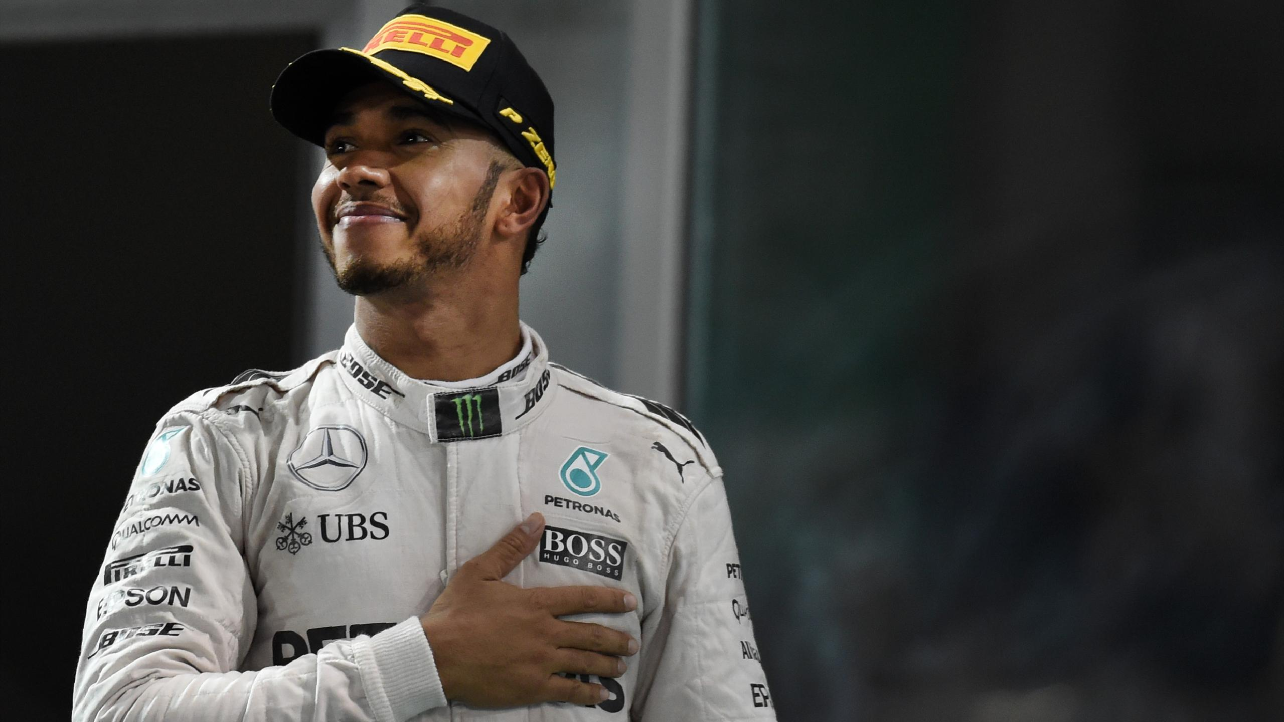 Mercedes AMG Petronas F1 Team's British driver Lewis Hamilton celebrates after winning the Abu Dhabi Formula One Grand Prix at the Yas Marina circuit