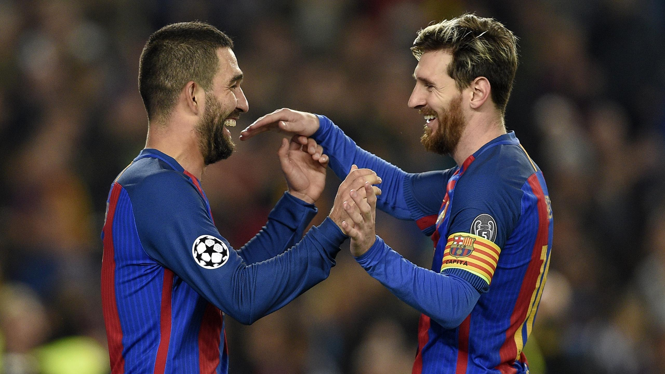 Barcelona's Turkish forward Arda Turan (L) celebrates with Barcelona's Argentinian forward Lionel Messi