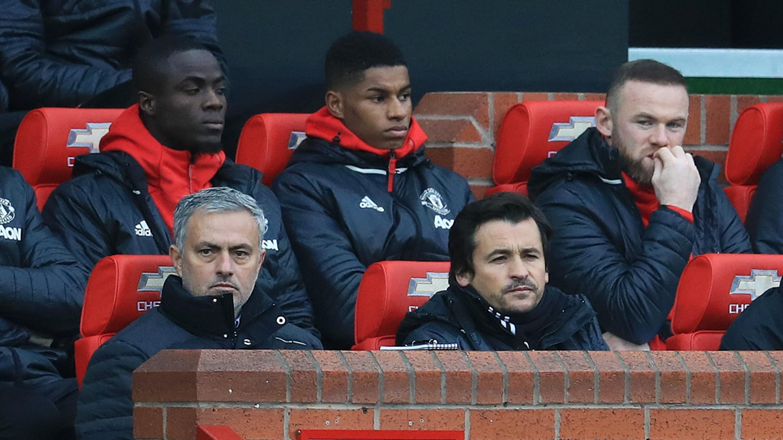 Manchester United manager Jose Mourinho (front left) on the bench next to assistant Rui Faria (front right), Eric Bailly (back left), Marcus Rashford (back centre) and Wayne Rooney