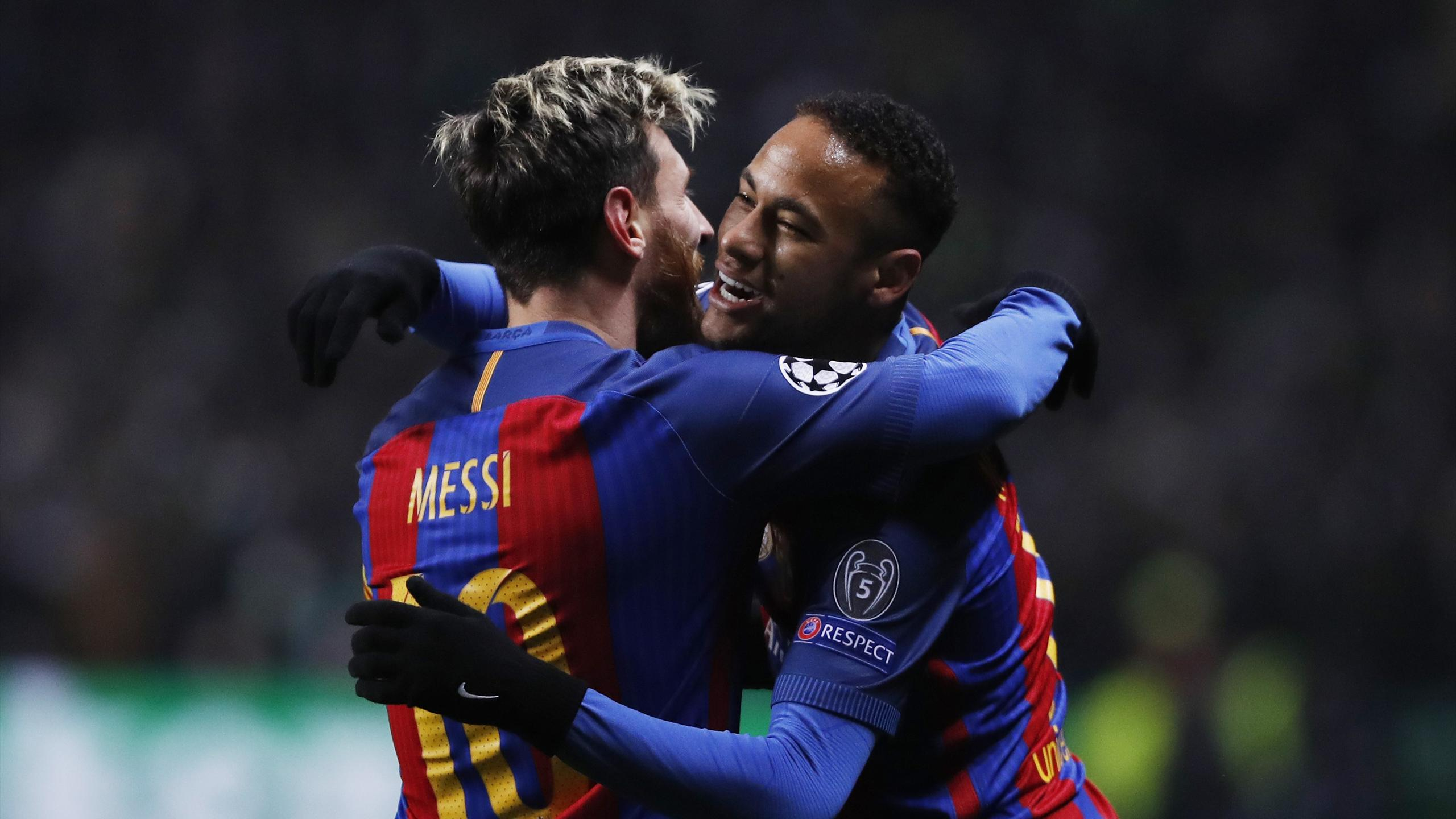 Barcelona's Lionel Messi and Neymar embrace