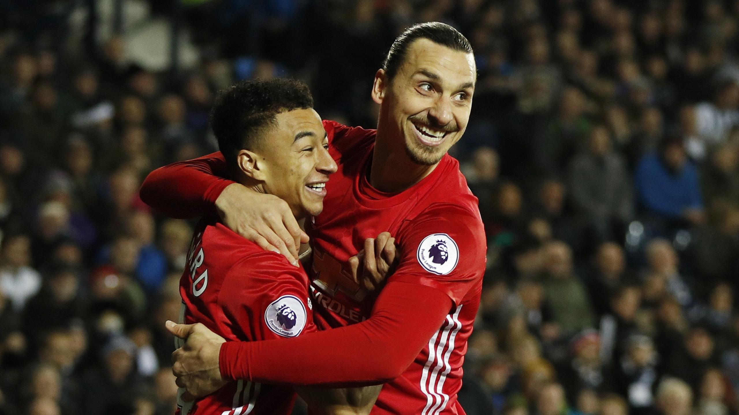 Manchester United's Zlatan Ibrahimovic celebrates scoring their first goal with Jesse Lingard